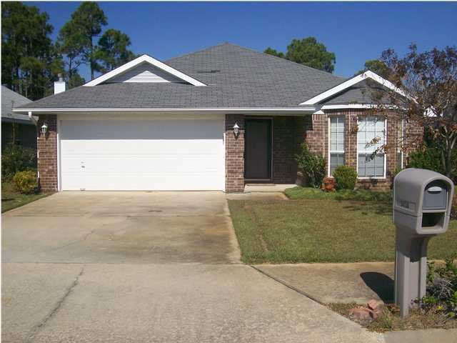 Photo of home for sale at 9414 Pine Lilly, Navarre FL