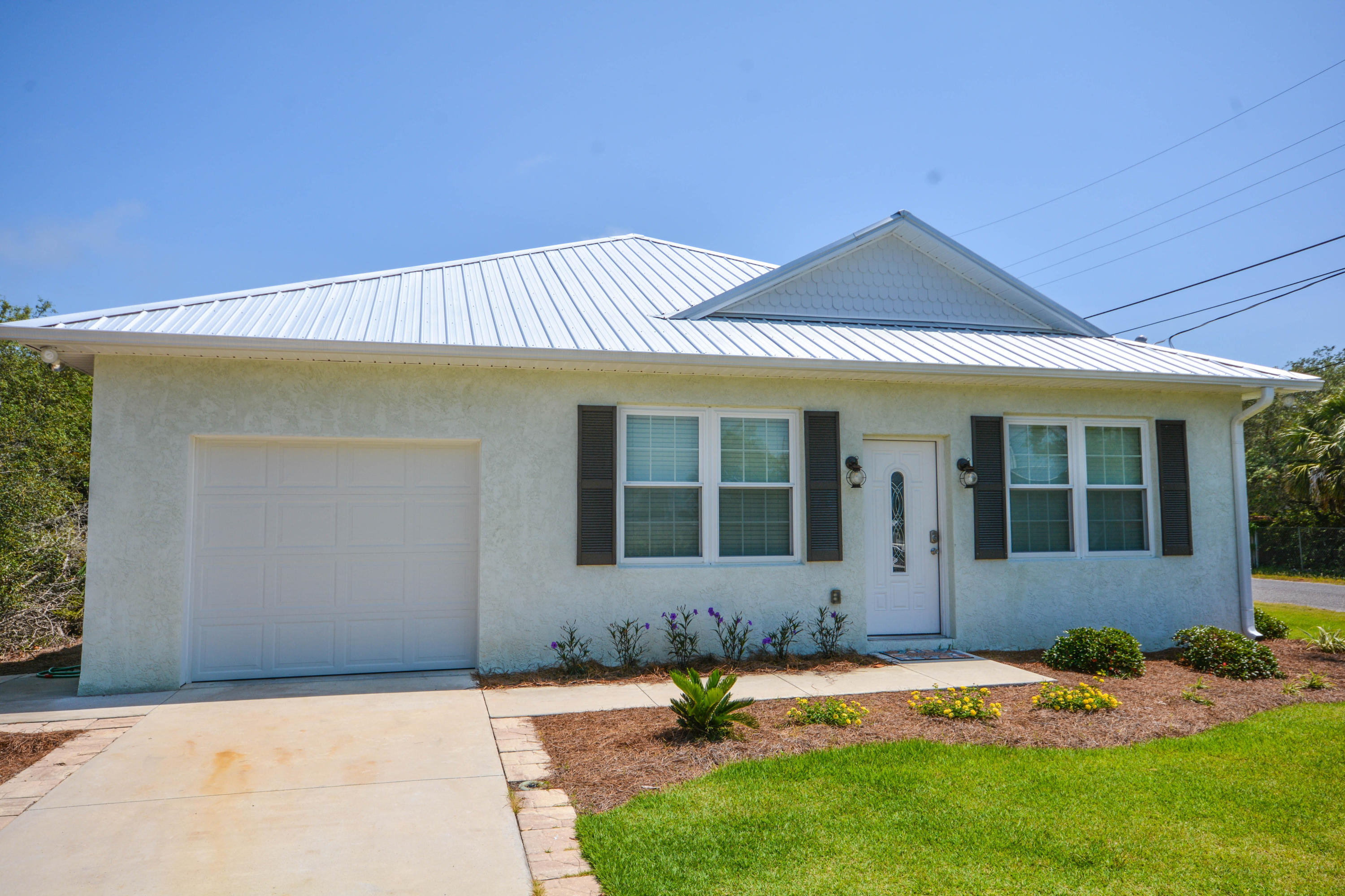 Photo of home for sale at 20718 First, Panama City Beach FL