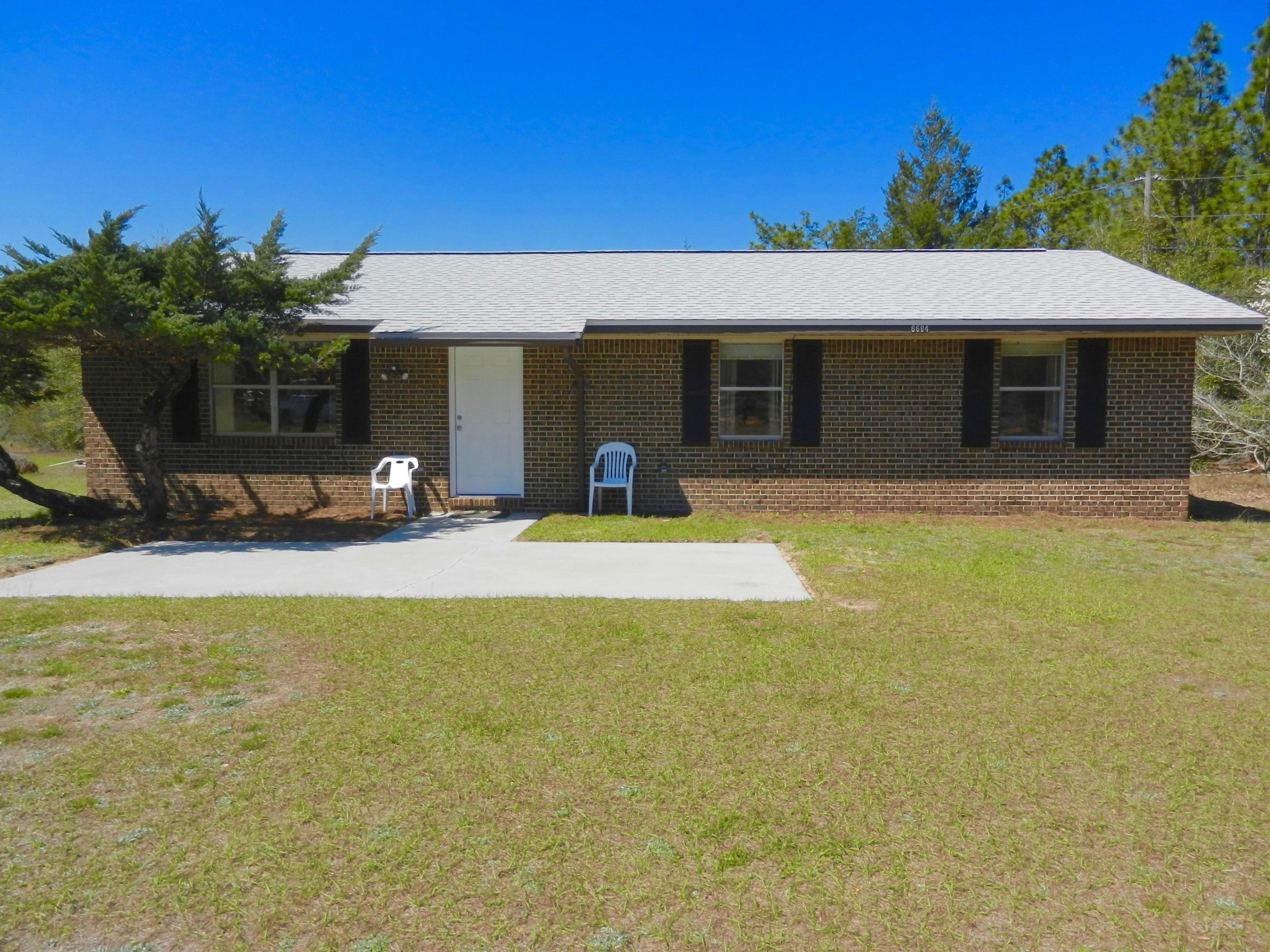 Photo of home for sale at 6684 Will Owens Rd, Laurel Hill FL