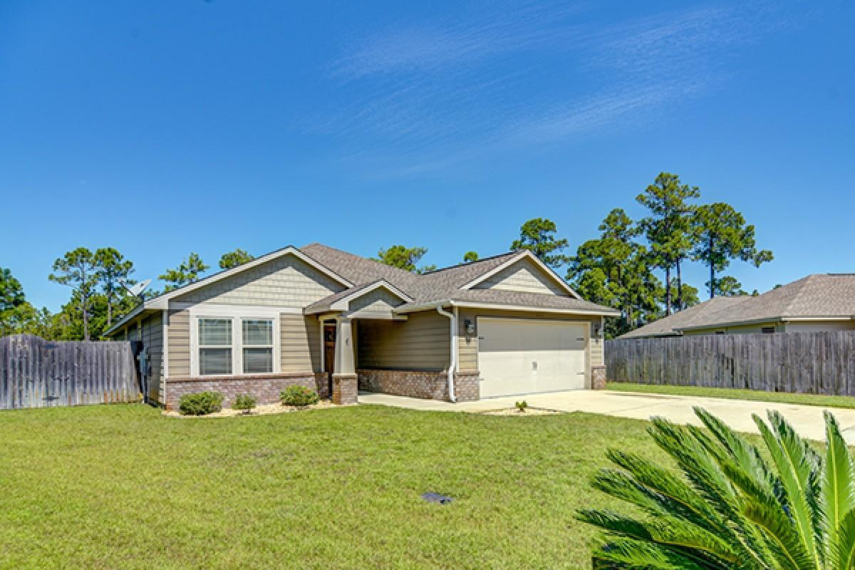 Photo of home for sale at 9250 Tarrant, Navarre FL