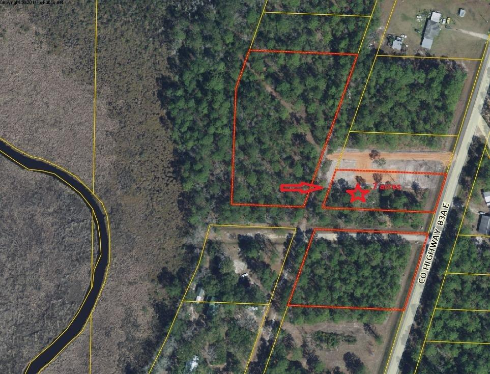 Photo of home for sale at 2404 County Road 83, Freeport FL