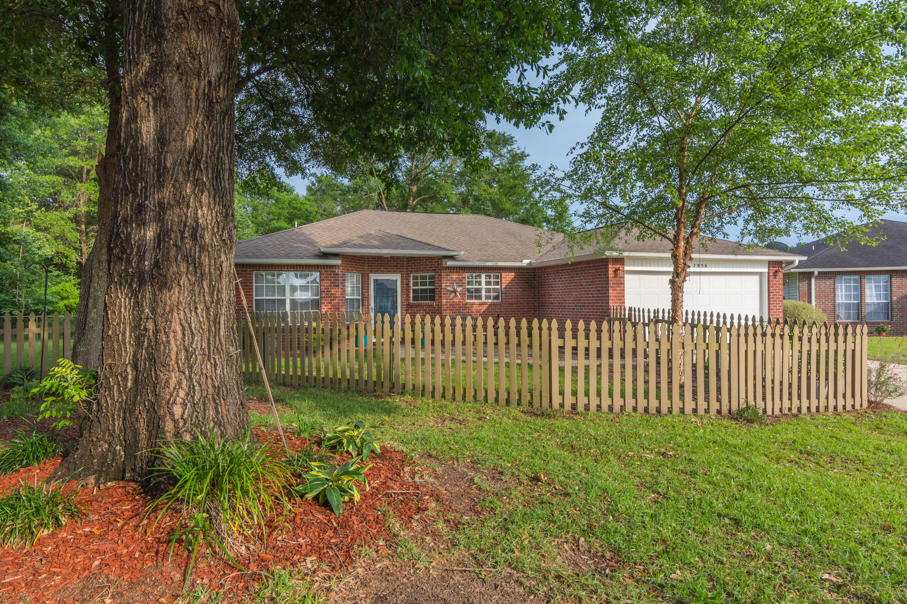 Photo of home for sale at 7036 Tylerwood, Milton FL