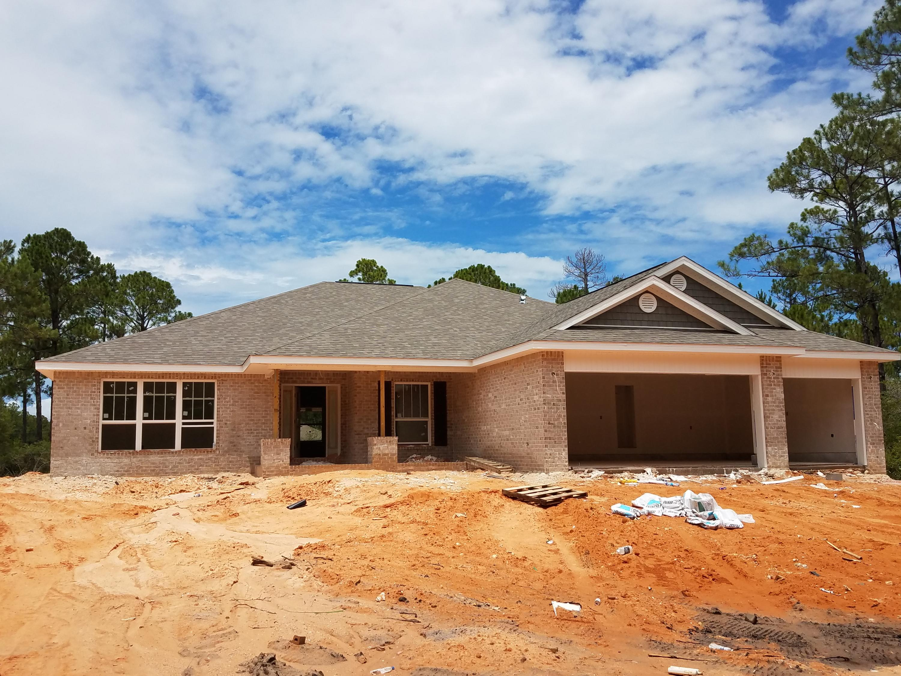 Photo of home for sale at 6704 Redfield, Navarre FL