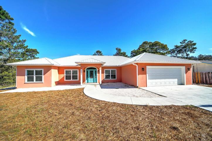Photo of home for sale at 21718 Pompano, Panama City Beach FL