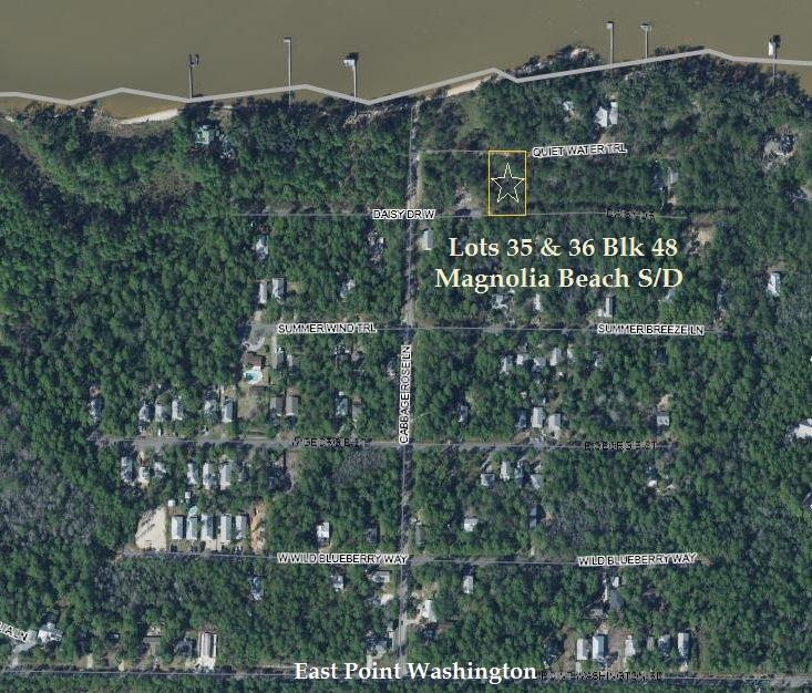Great double lot in a secluded neighborhood located in Point Washington.  Lot sits between Quiet Water Trail and East Daisy Drive.  Community Bay access at the end of Cabbage Rose Lane.