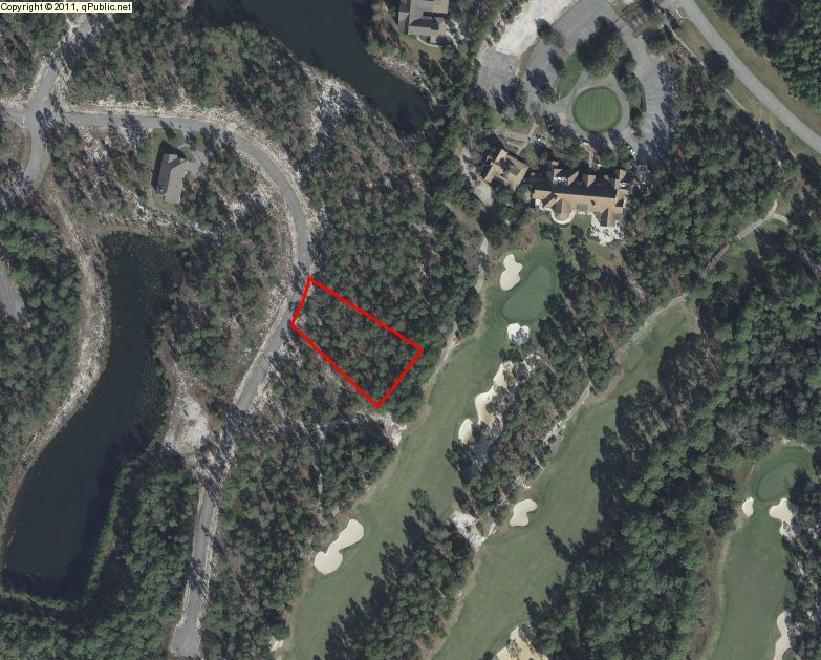 Fabulous Home-site lot on 0.6 of an acre located in desirable Wild Heron.  Lot back up to the green and located close to Sharks Tooth Club house.  Wild Heron is a 750 acre development that offers many exclusive amenities such as community dock with use of kayaks and canoes for exploring Lake Powell one of the largest Coastal Dunes Lakes in the area. The community offers a community pool/Hot tub, Tennis Courts, Family Parks and a Championship Golf Course at Shark's Tooth Golf Club with around 24 miles worth of trails and walking path.  Now is a great opportunity to own and experience all life has to offer in this remarkable community.