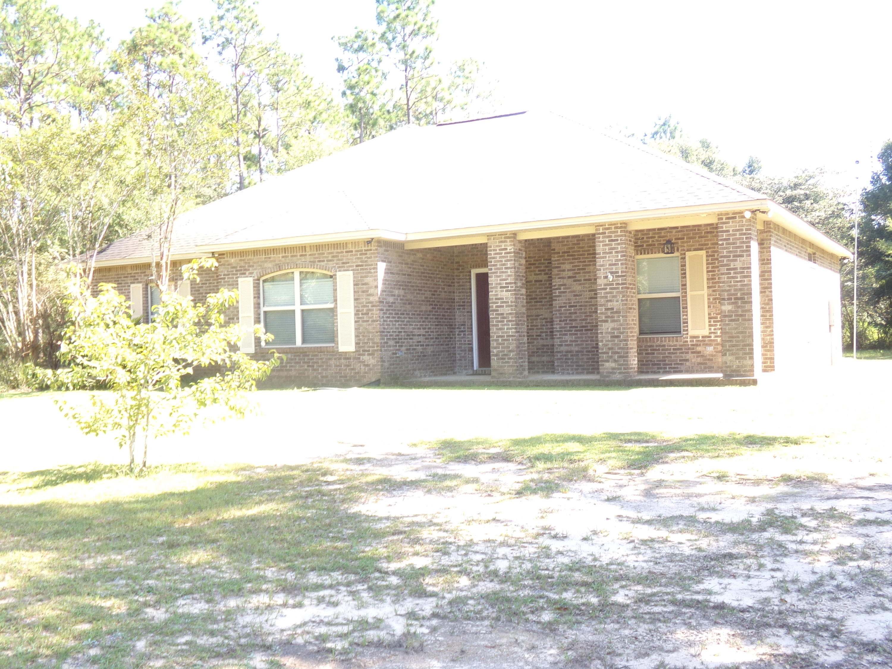 Photo of home for sale at 4613 Bryant Bridge, Holt FL