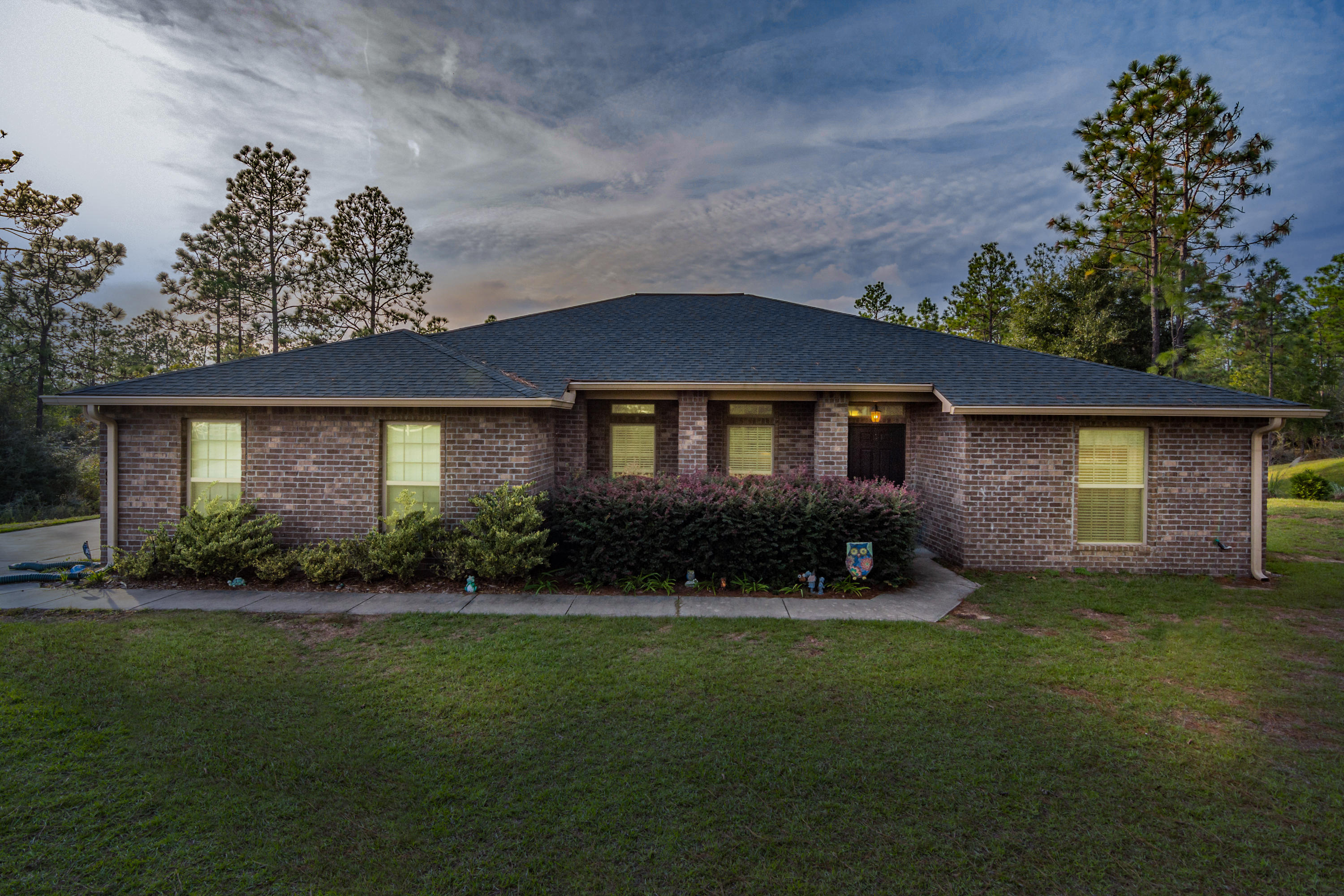 Photo of home for sale at 6468 Welannee, Laurel Hill FL