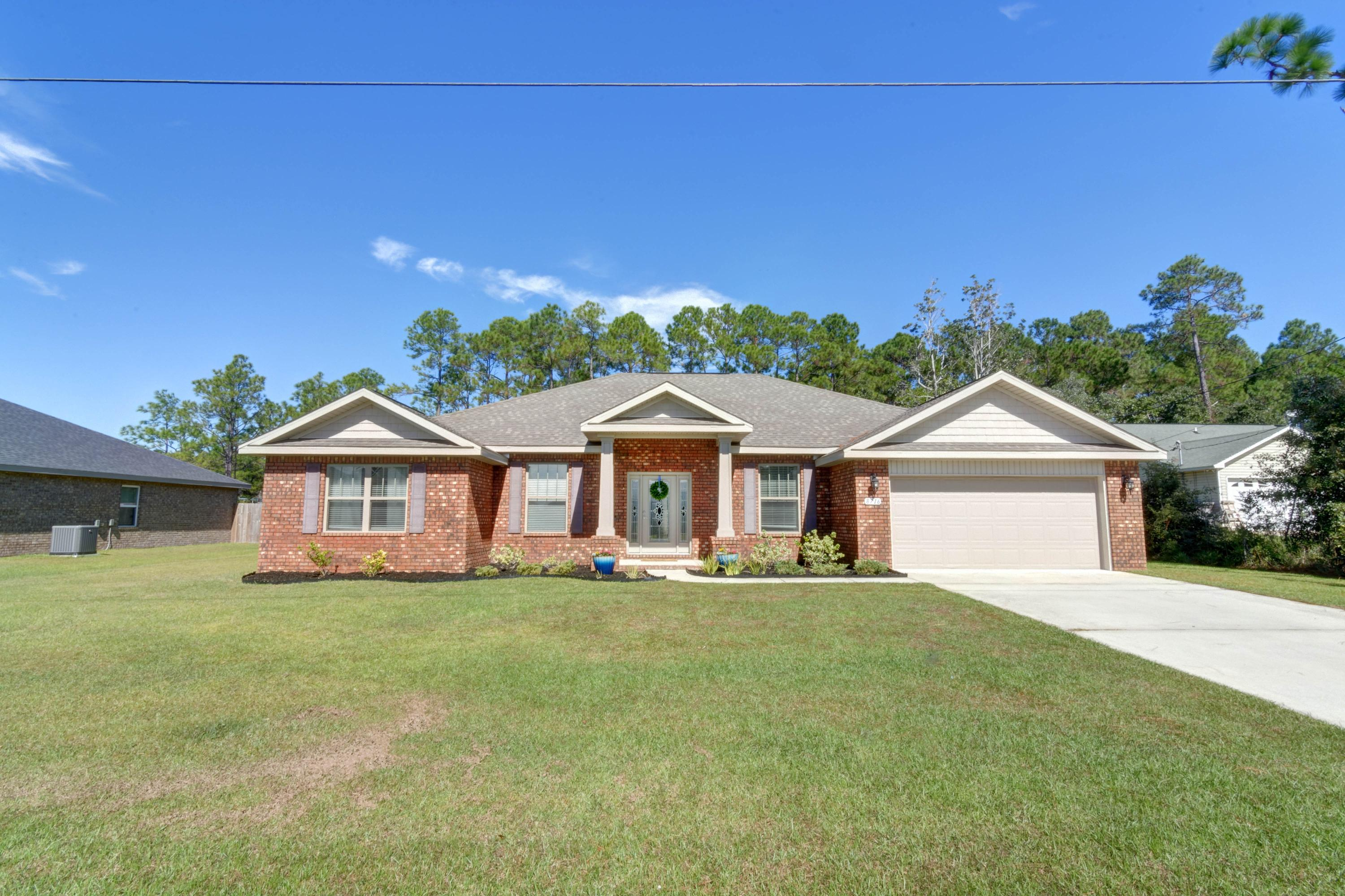 Photo of home for sale at 8716 Olivera, Navarre FL
