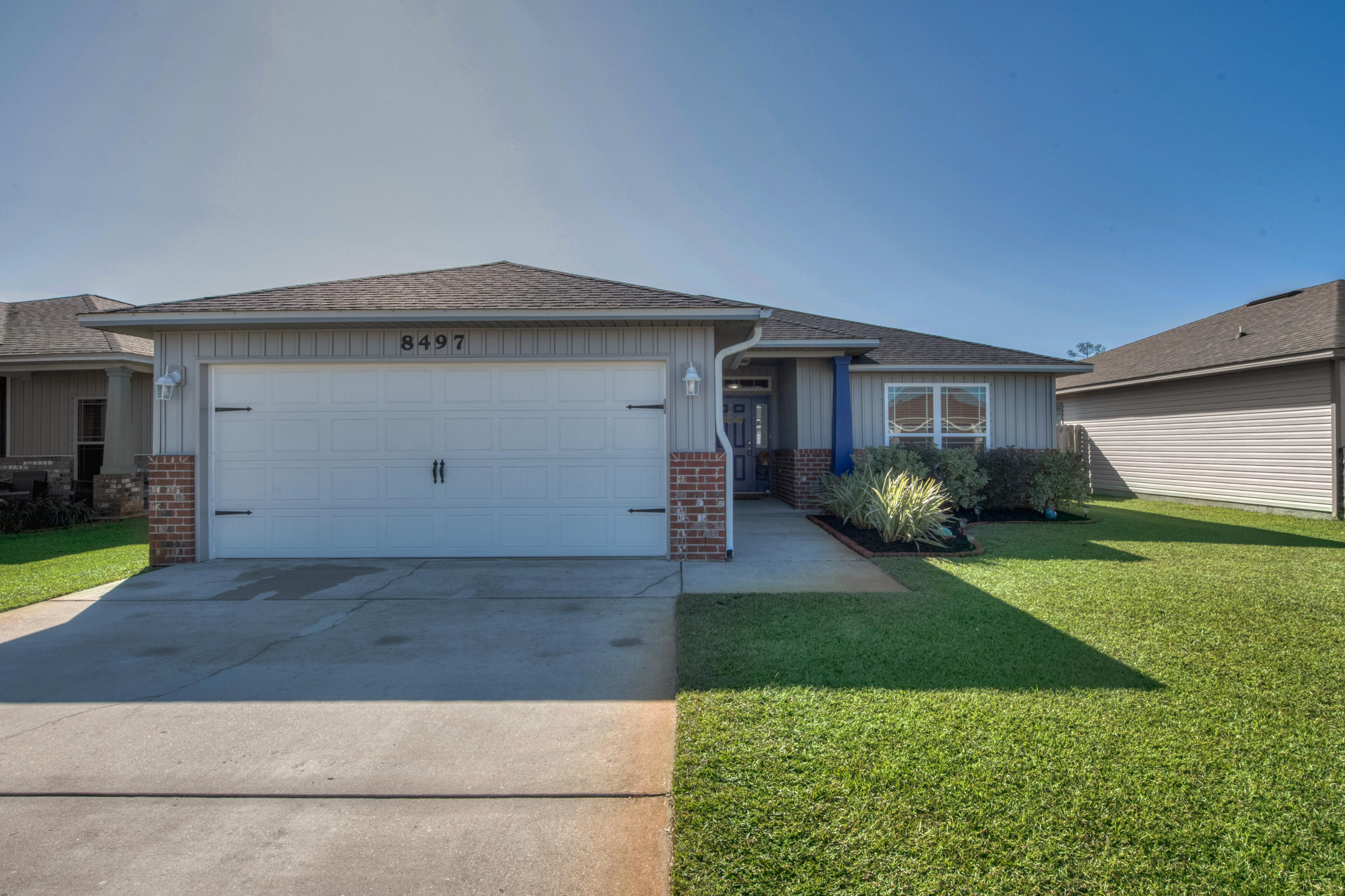 Photo of home for sale at 8497 Island, Navarre FL