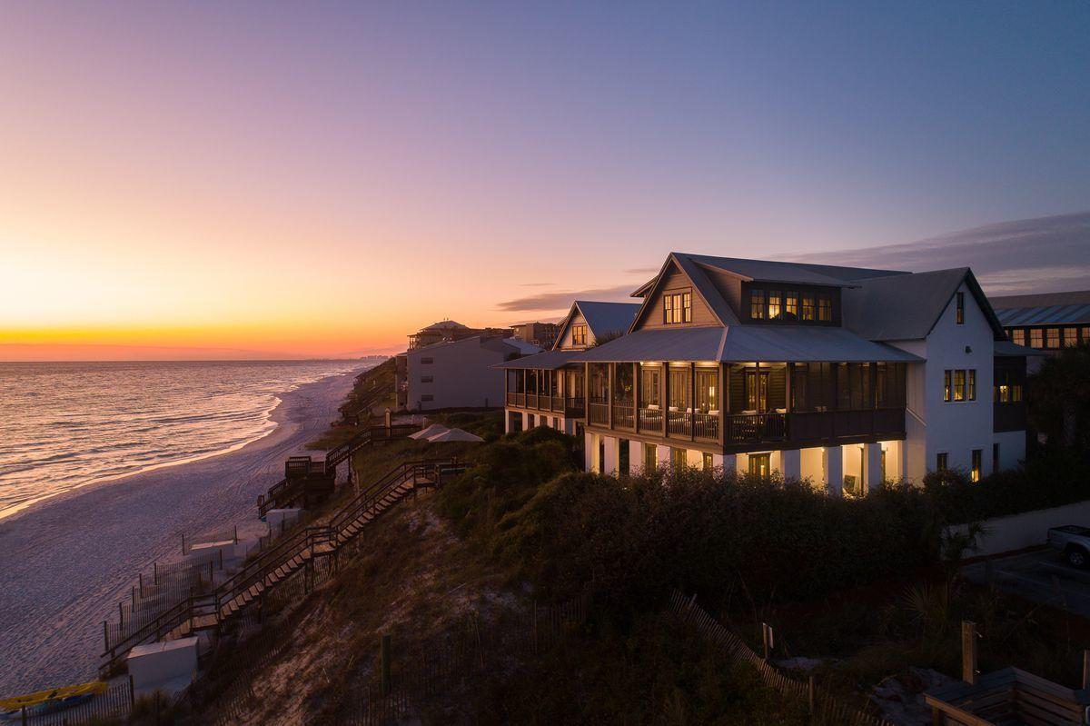 This luxurious Gulf-front home resides on the high bluffs of Blue Mountain Beach. The design and con