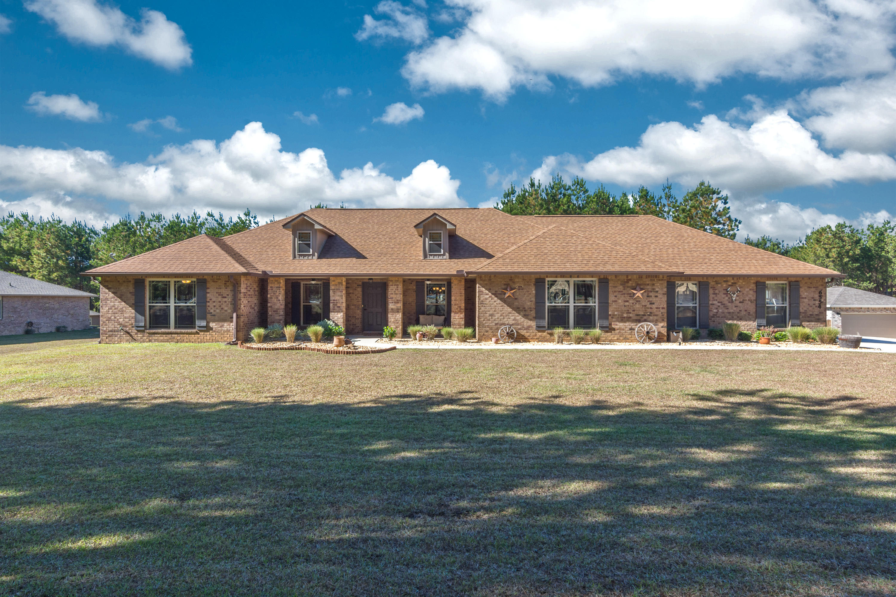 Photo of home for sale at 6554 Welannee, Laurel Hill FL