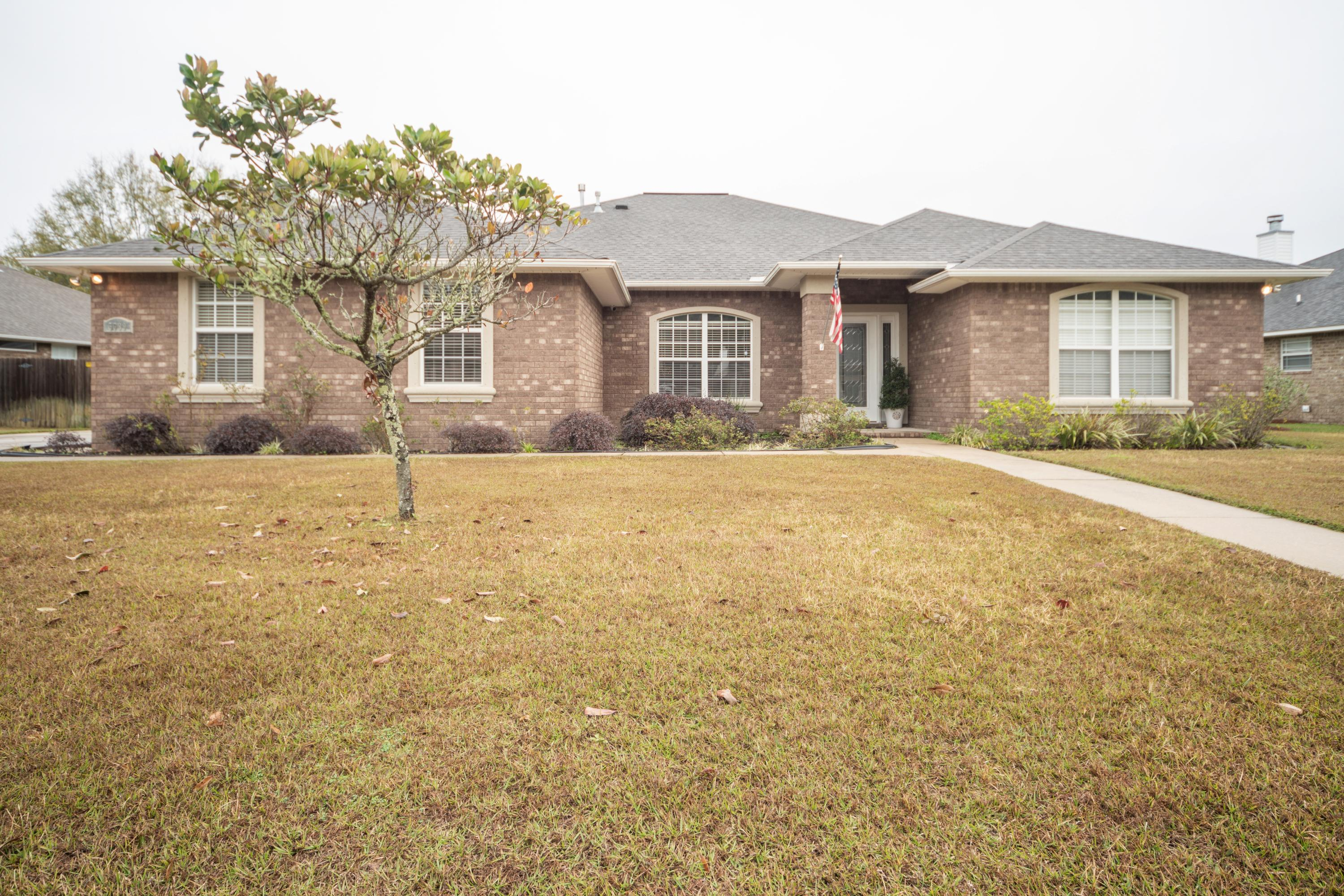 Welcome home to this 4 bedroom 3 bath brick ranch located in a gated community across the street fro
