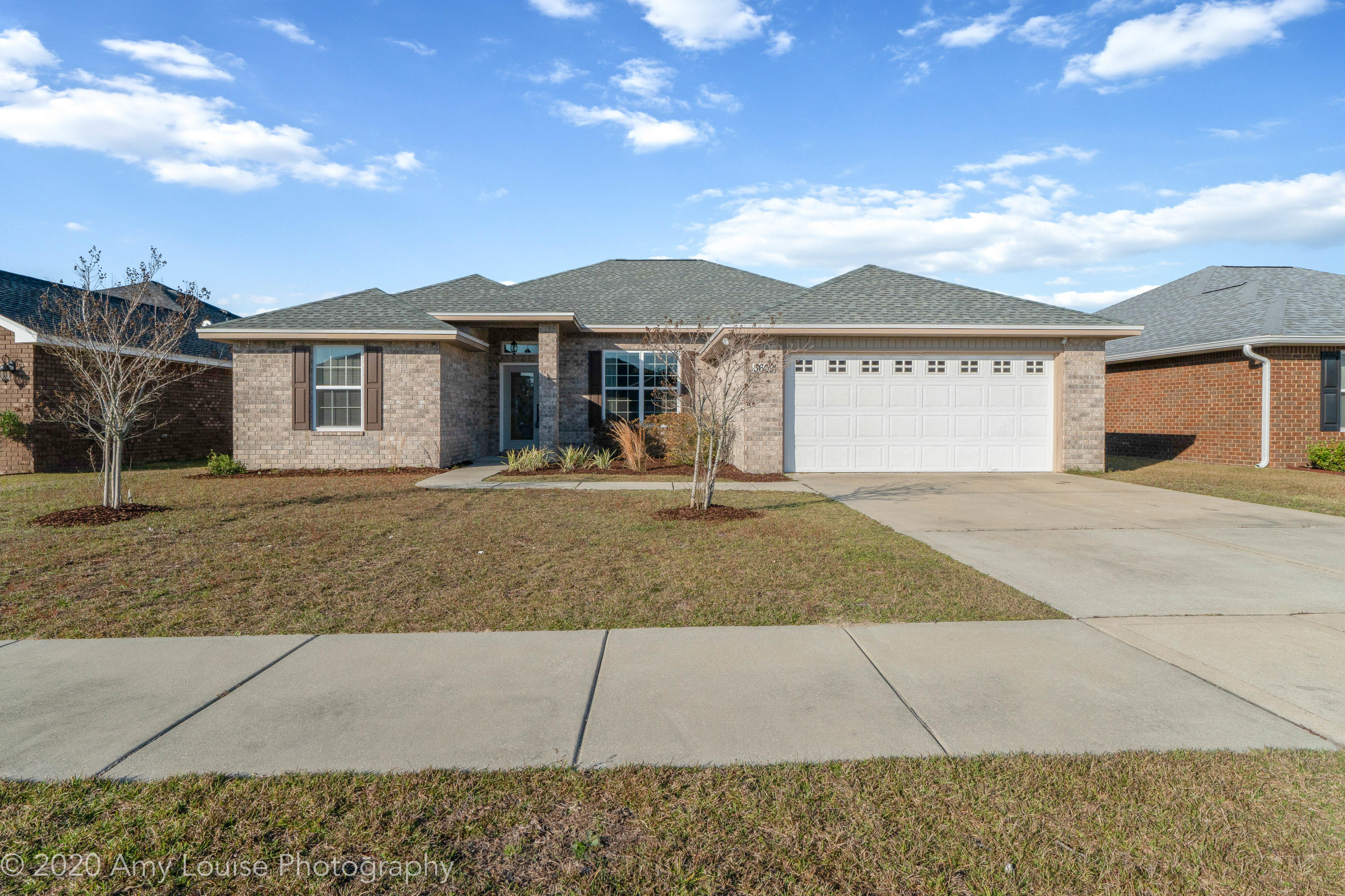 Welcome to this newer 4 bedroom POOL home located in a central neighborhood with sidewalks. This all brick home has a new roof, fresh paint, tall ceilings, wood flooring and wonderful finishes throughout! The home features a split floor plan with two bedrooms towards the front of the home, a 3rd additional bedroom tucked in the back of the home. On the other side of the kitchen is the master bedroom with new carpet and gorgeous master bathroom!The kitchen and open living area enjoys beautiful views of the private backyard with gunite pool. The kitchen has stainless steel appliances, white cabinets, granite counters and updated lighting. The living room has fabulous wood flooring, detailed trim work and neutral paint.
