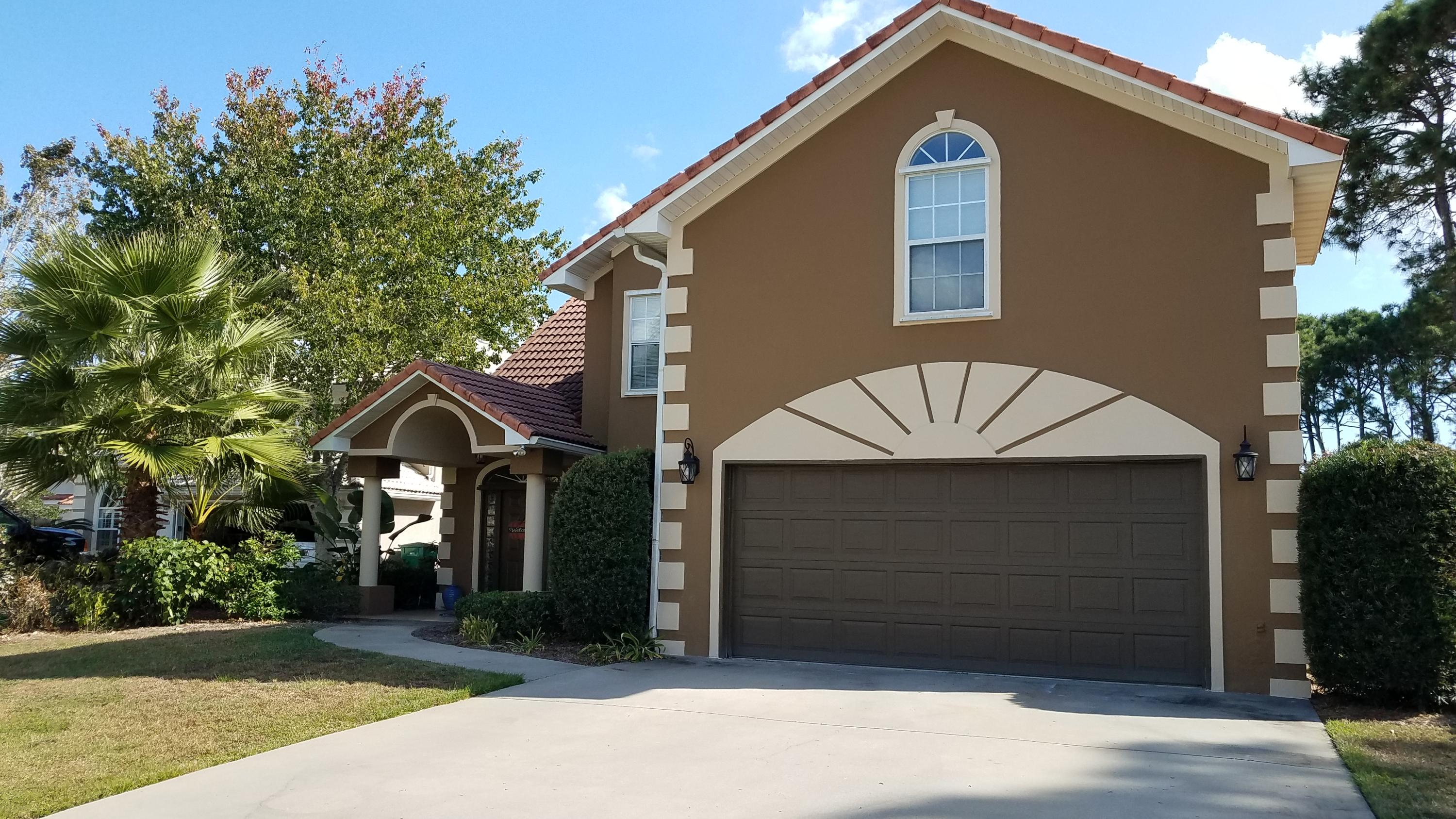 This spacious newly updated home is in Emerald Bay, a gated community, located on the 4th hole of th