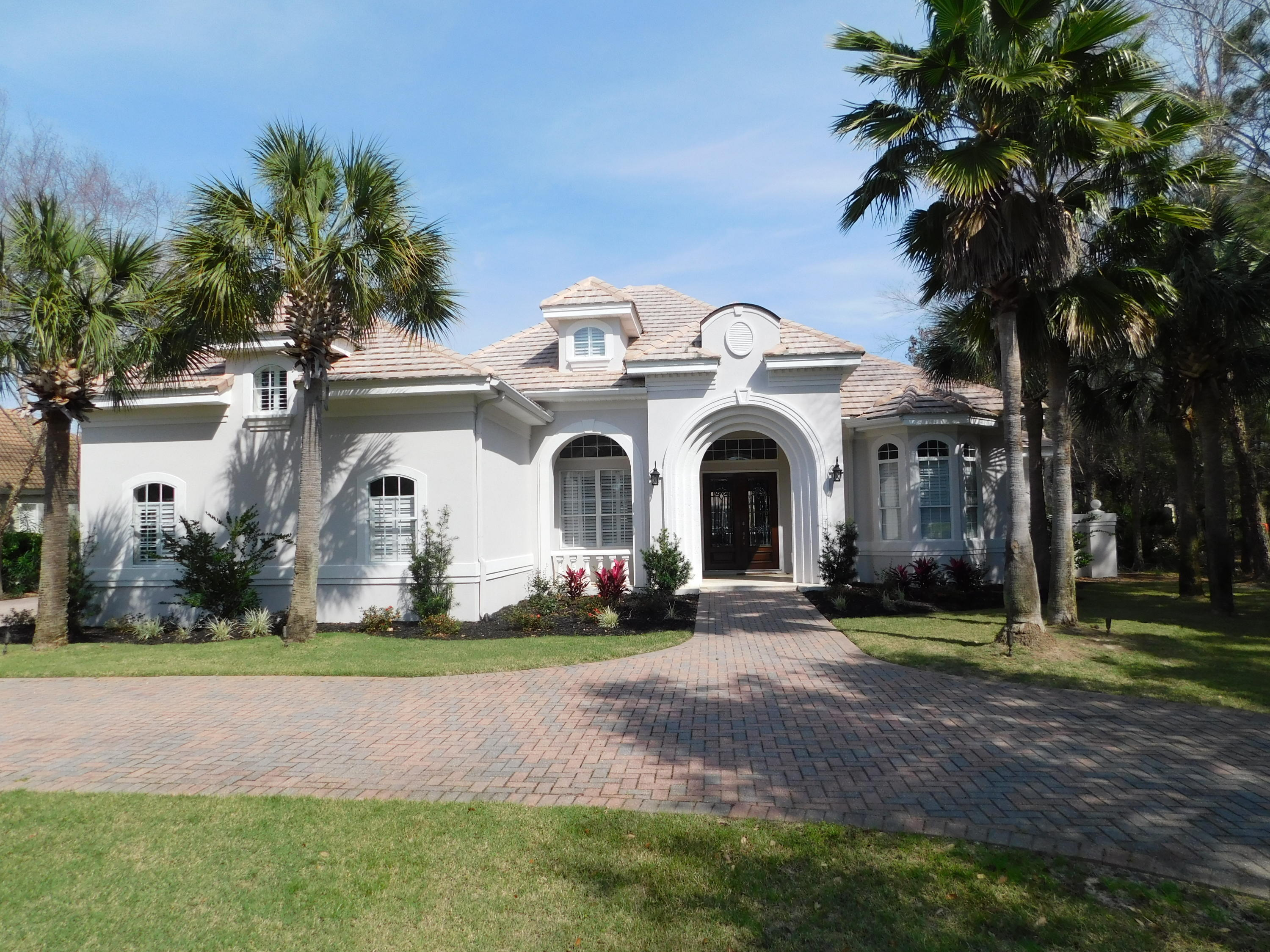 Come Home to your Majestic Tuscan Style Lake Home, located within the gates of Regatta Bay Golf and