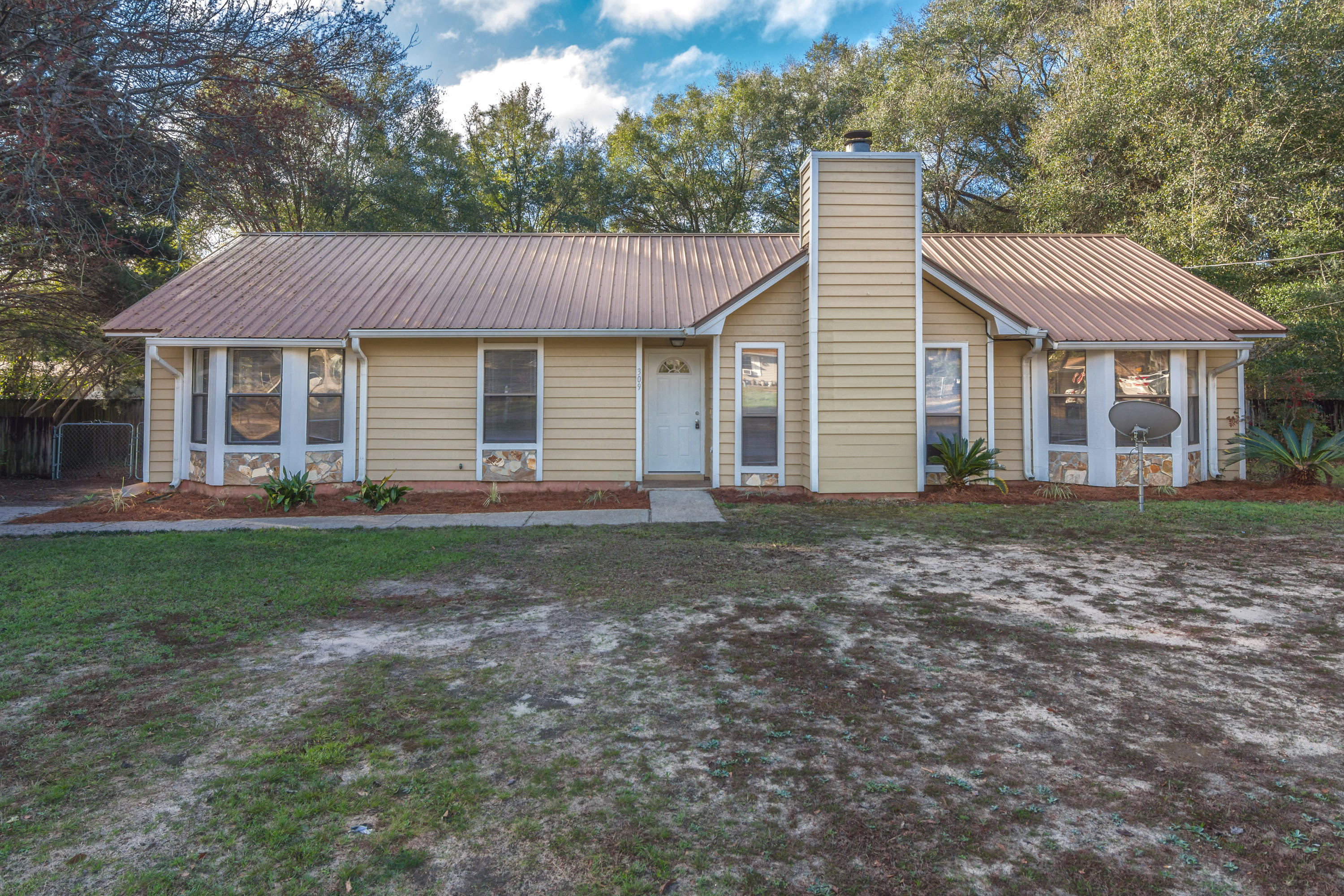 4 Bedroom 2 bath move in ready home located in the middle of Crestview with easy commute to the loca