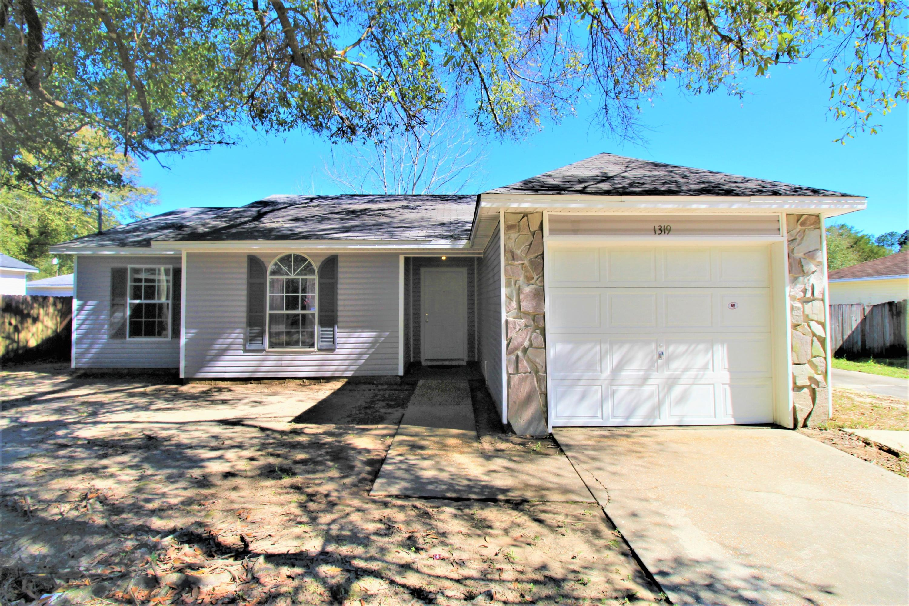 Located in the heart of Crestview, this home is ready to be loved! High ceilings, tall windows, and