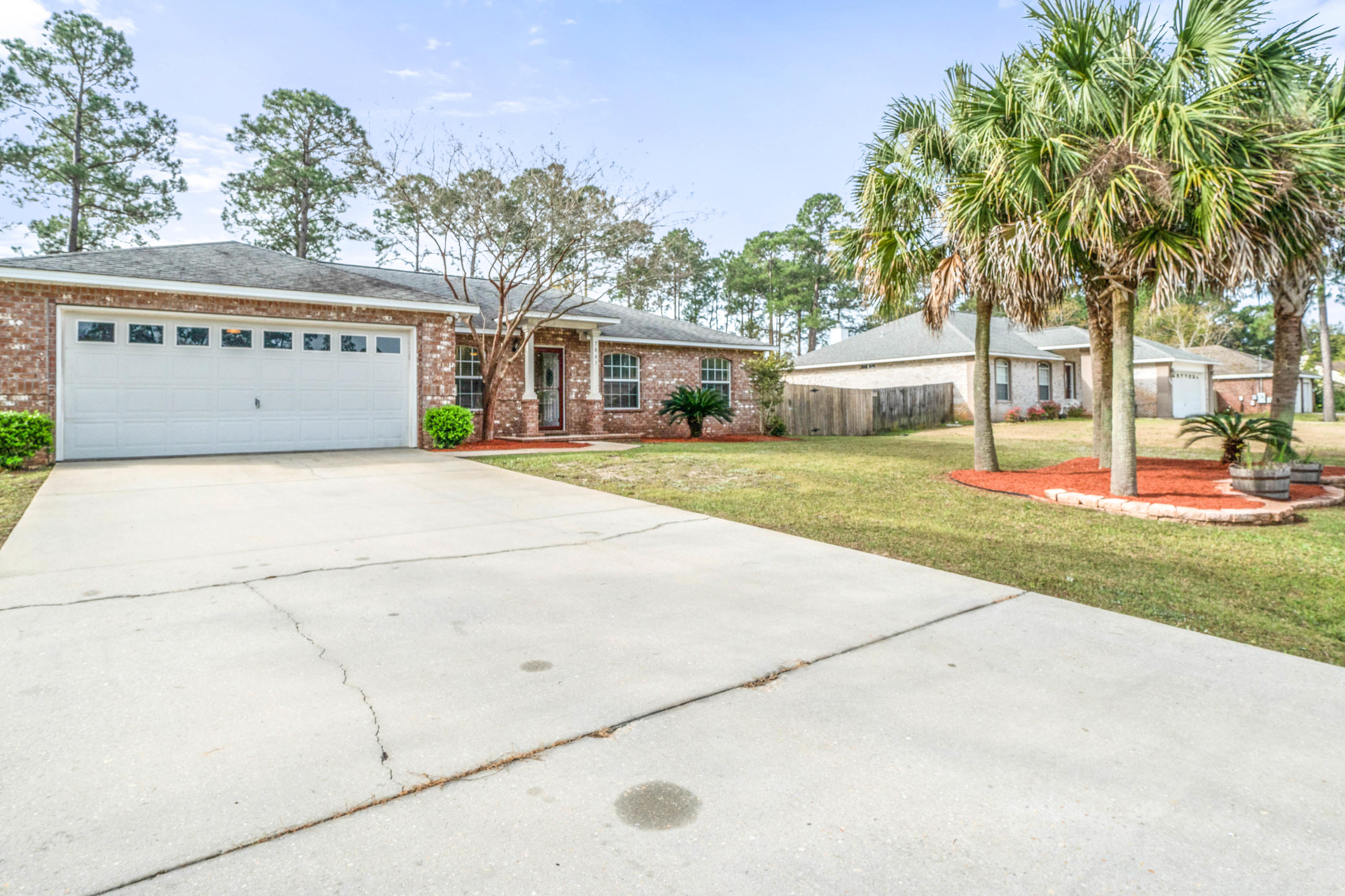 Photo of home for sale at 7047 Jasper, Navarre FL