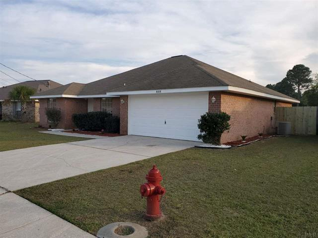 Photo of home for sale at 8103 Hartington, Navarre FL