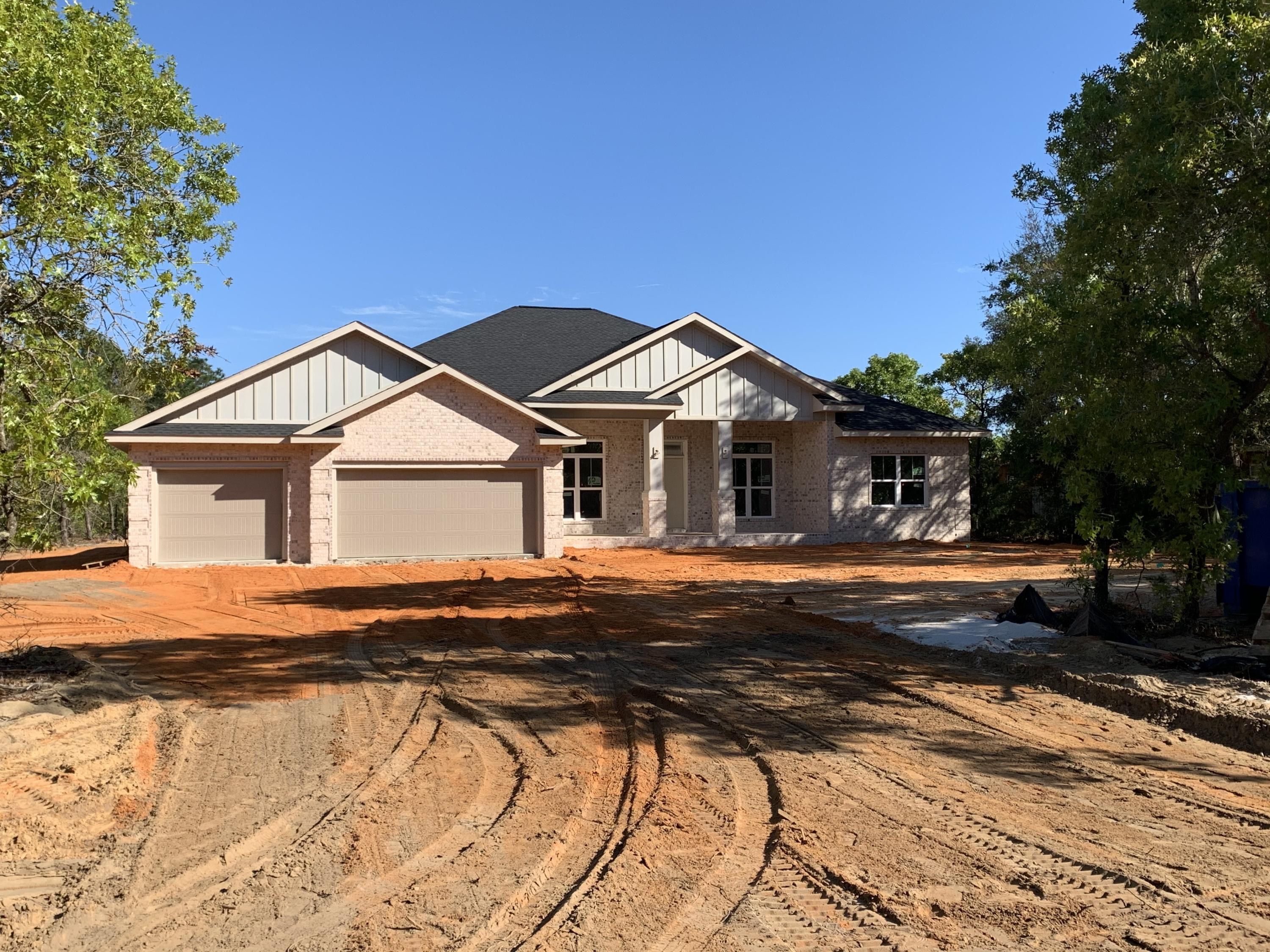 Photo of home for sale at 9517 Acorn, Navarre FL