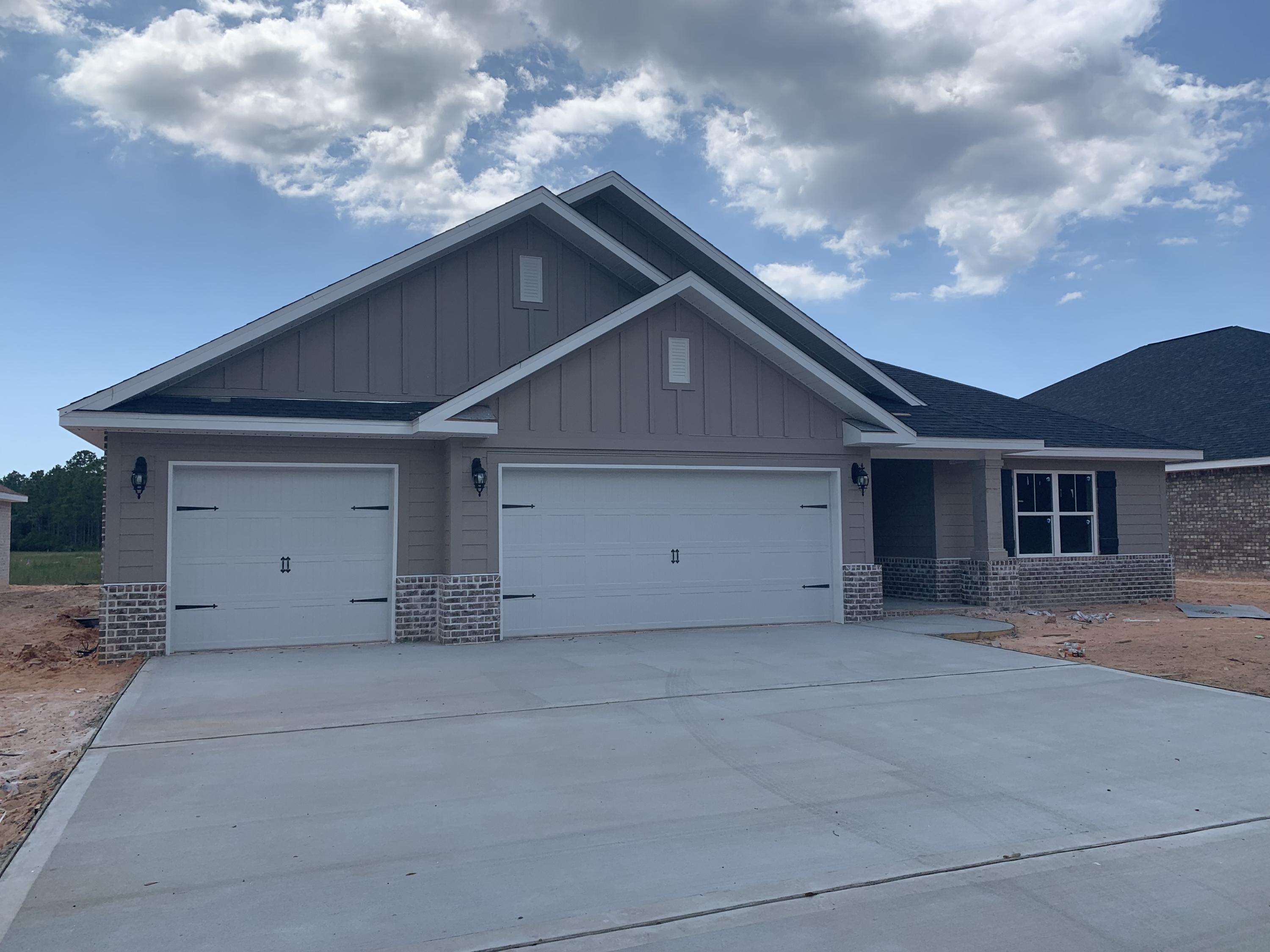 Photo of home for sale at 7097 Flintwood, Navarre FL