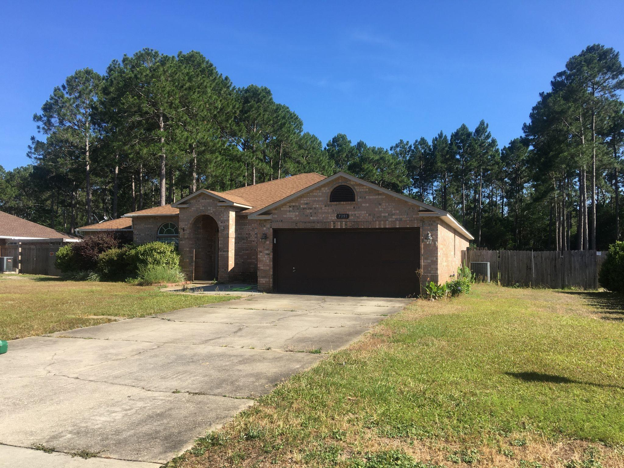 Photo of home for sale at 7391 Olympia, Navarre FL