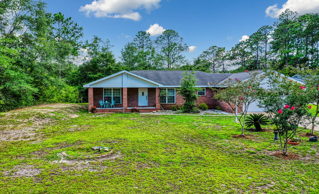 Photo of home for sale at 868 Mallet Bayou, Freeport FL