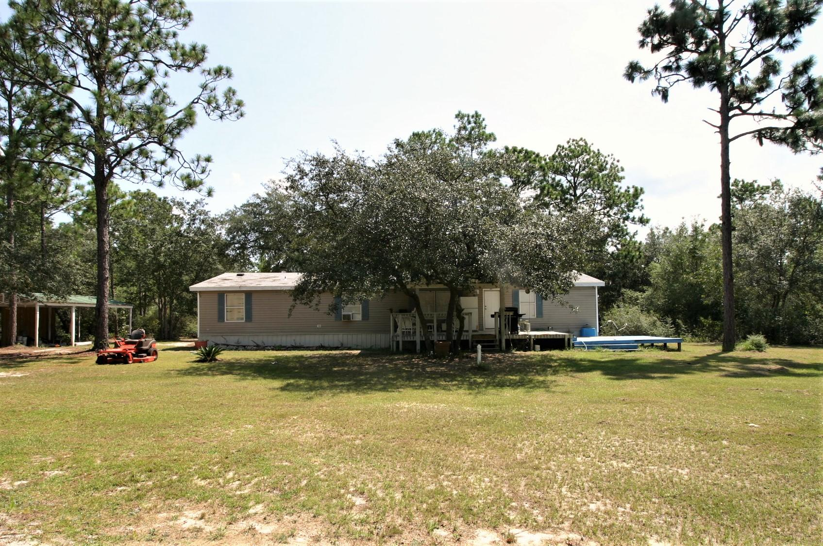 Photo of home for sale at 4236 Whippoorwill, Holt FL
