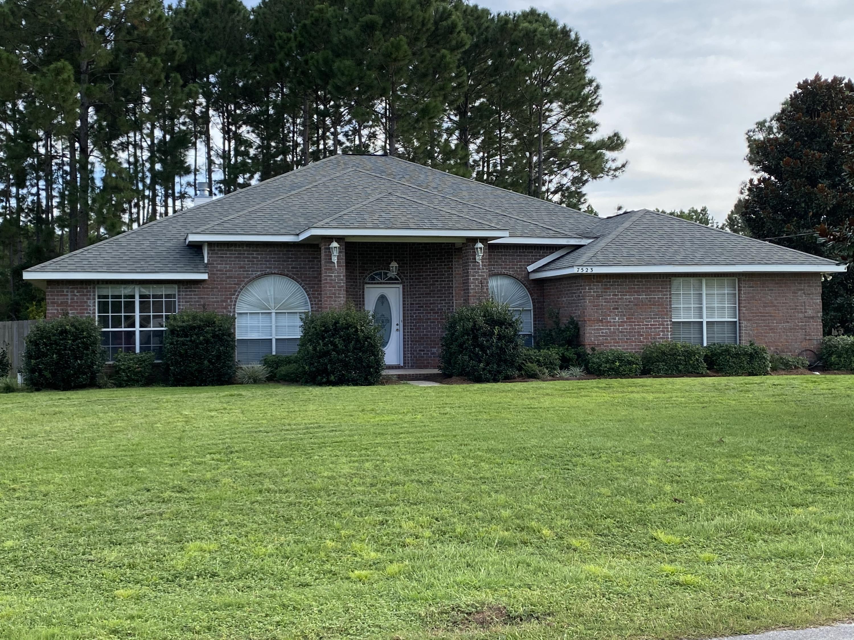 Photo of home for sale at 7523 Treasure, Navarre FL