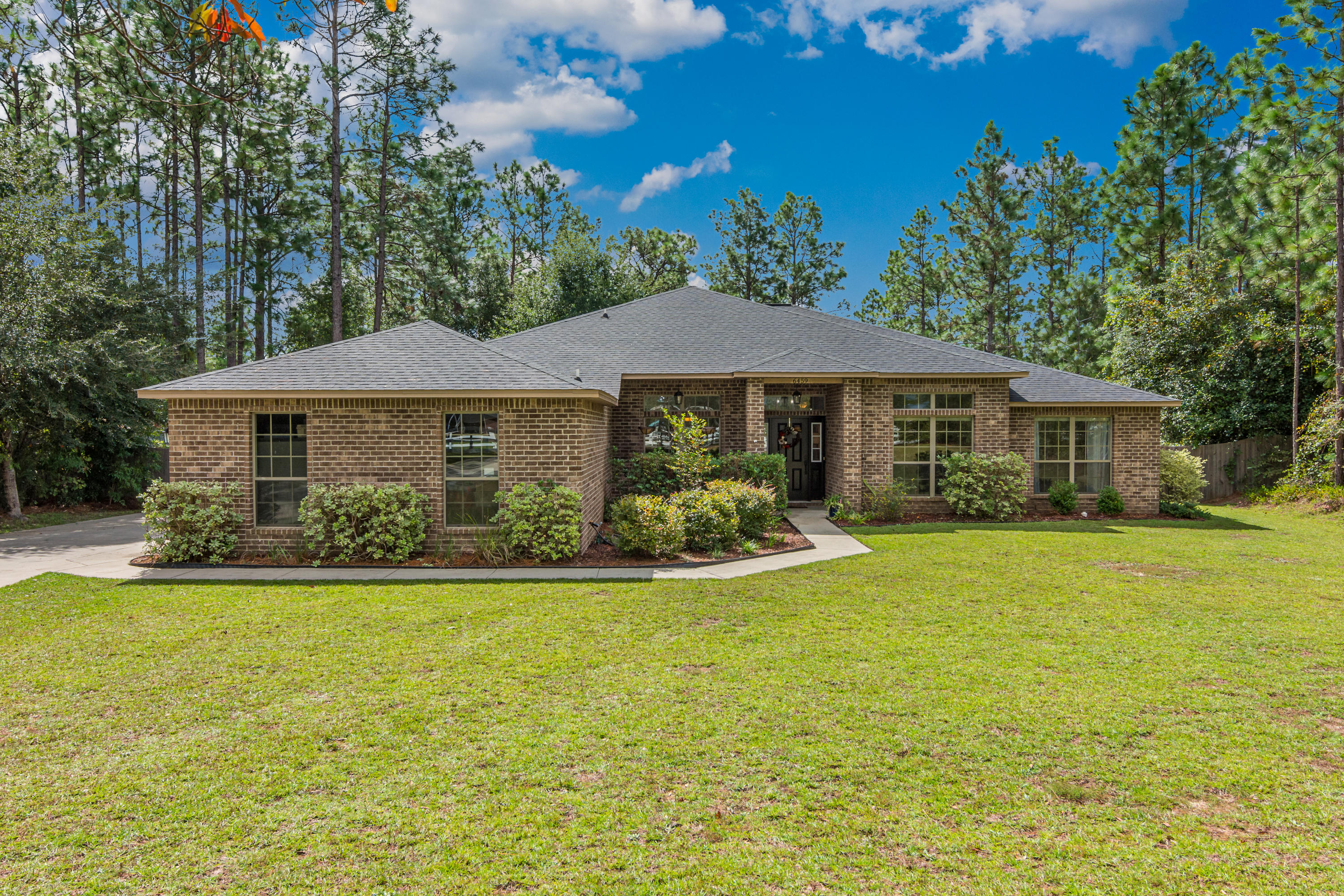 Photo of home for sale at 6459 Welannee, Laurel Hill FL