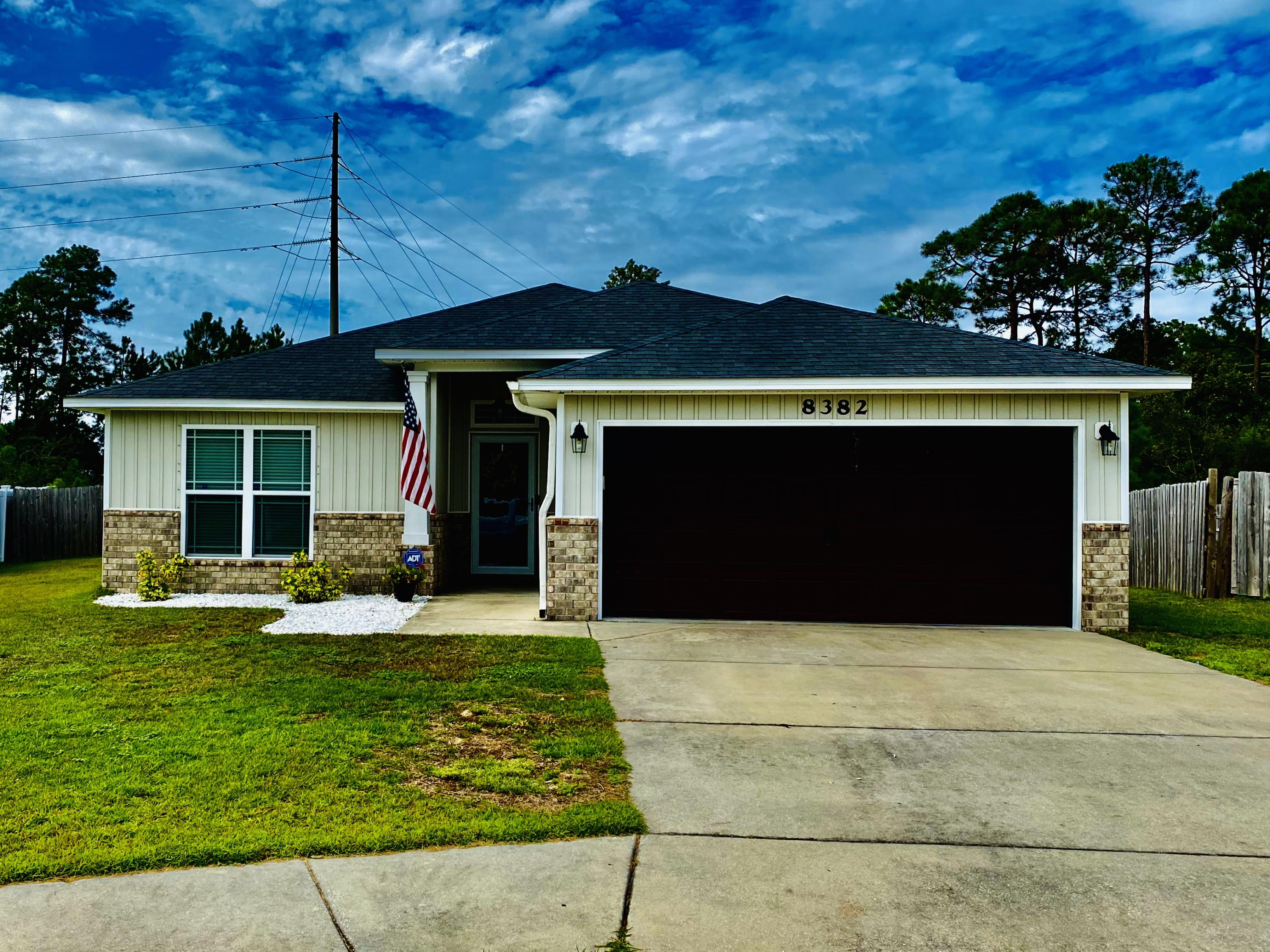 Photo of home for sale at 8382 Island, Navarre FL