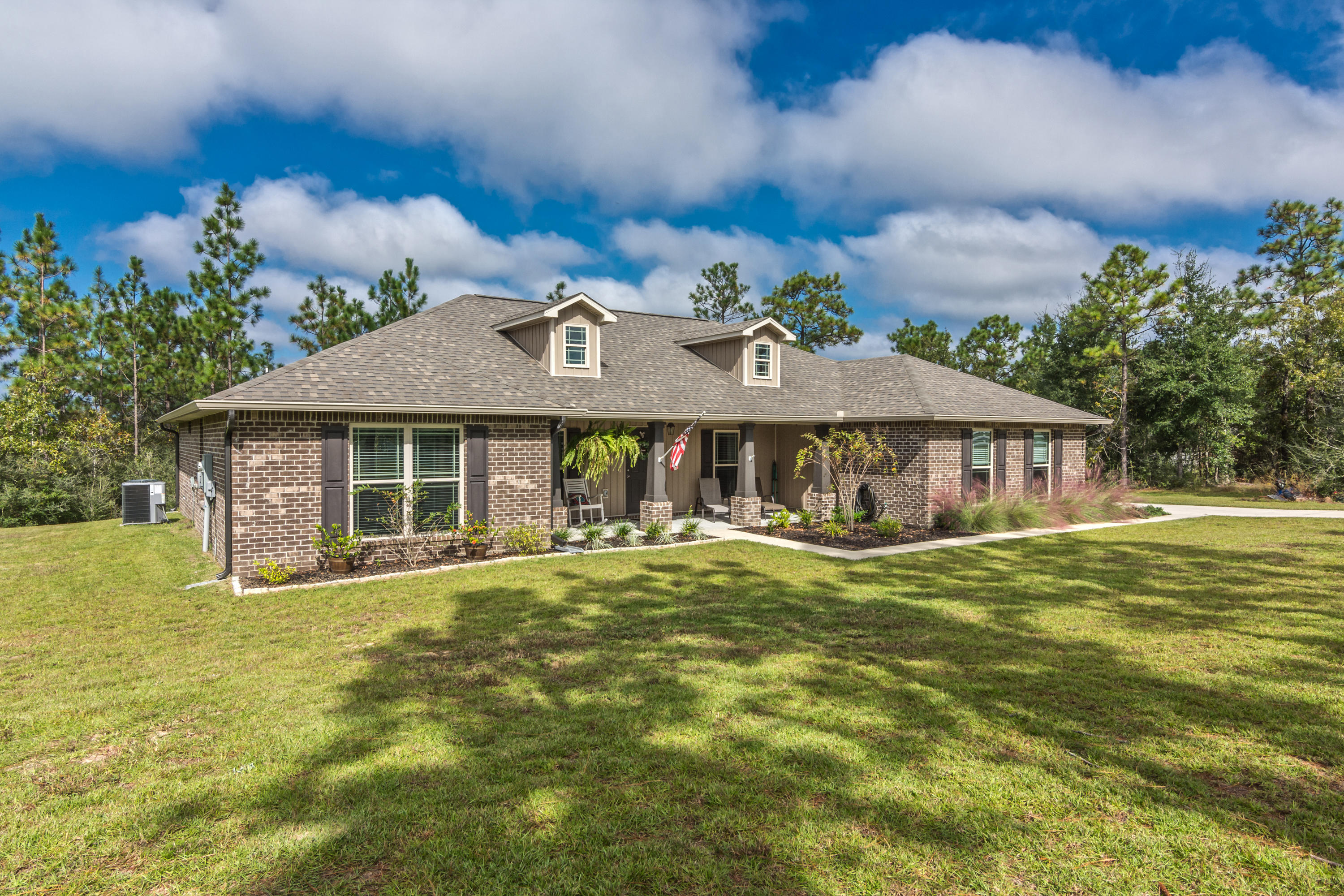 Photo of home for sale at 6420 Welannee, Laurel Hill FL