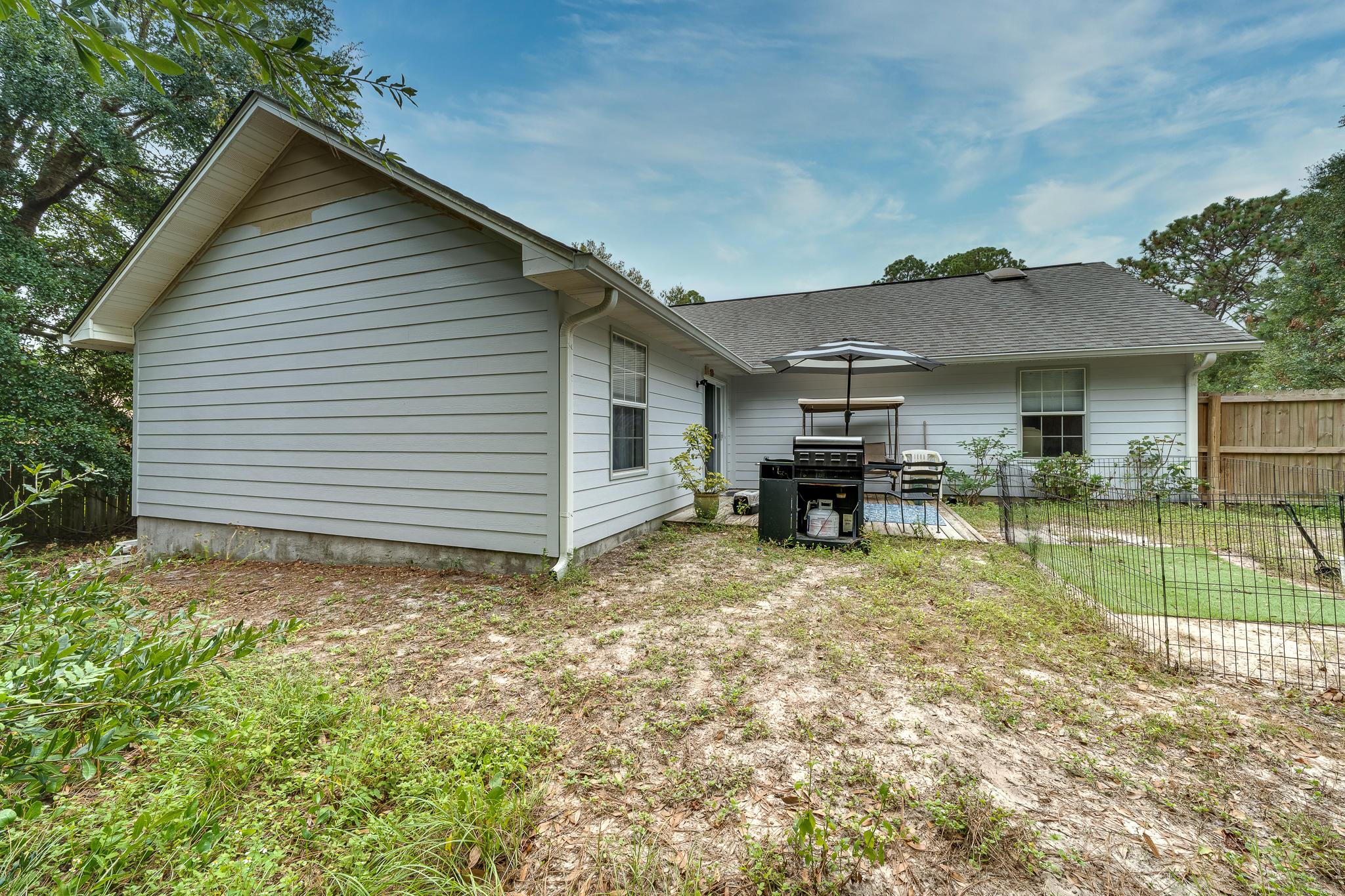 Photo of home for sale at 8408 Tavira, Navarre FL