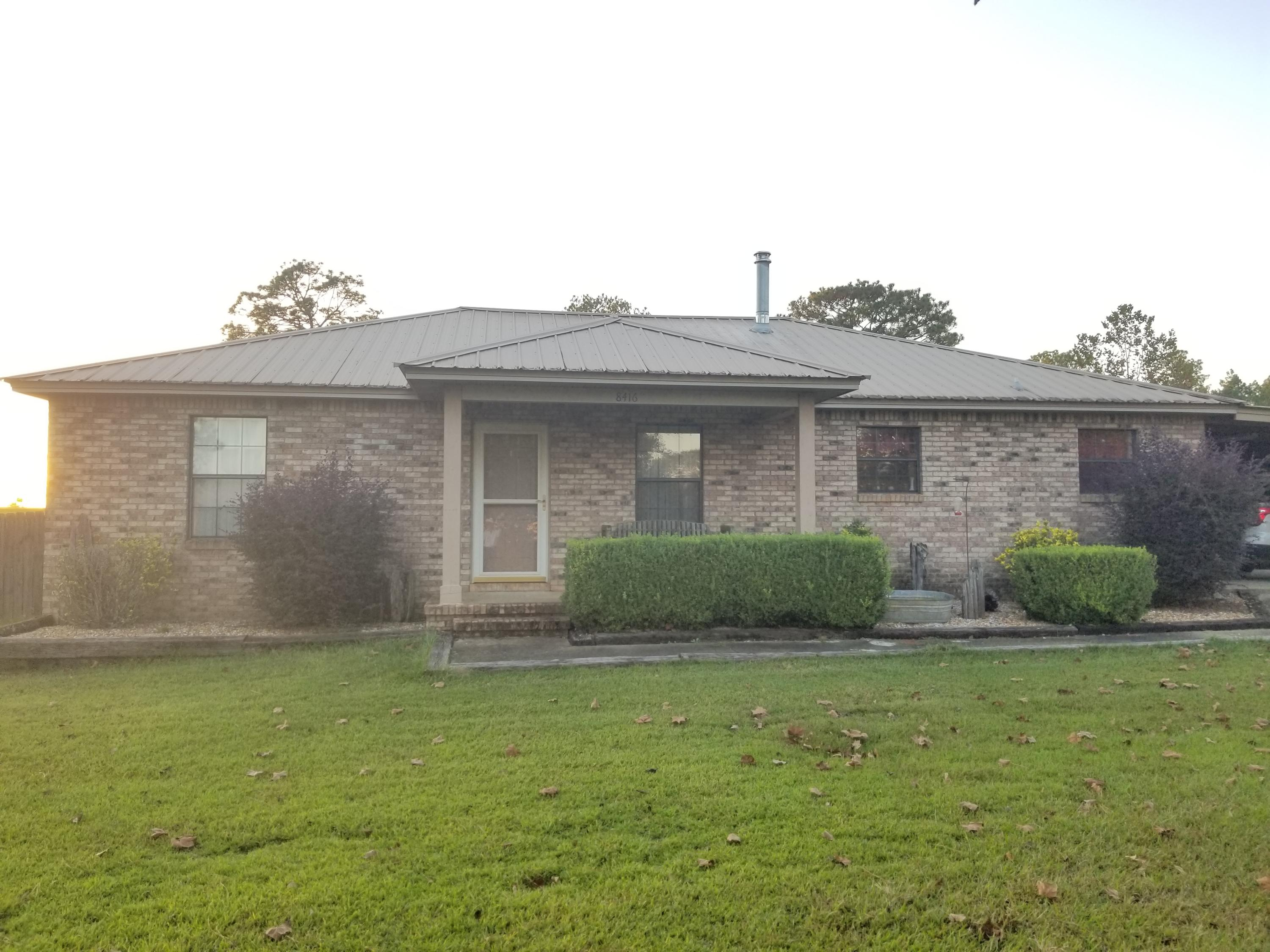 Photo of home for sale at 8416 Ludlum, Laurel Hill FL