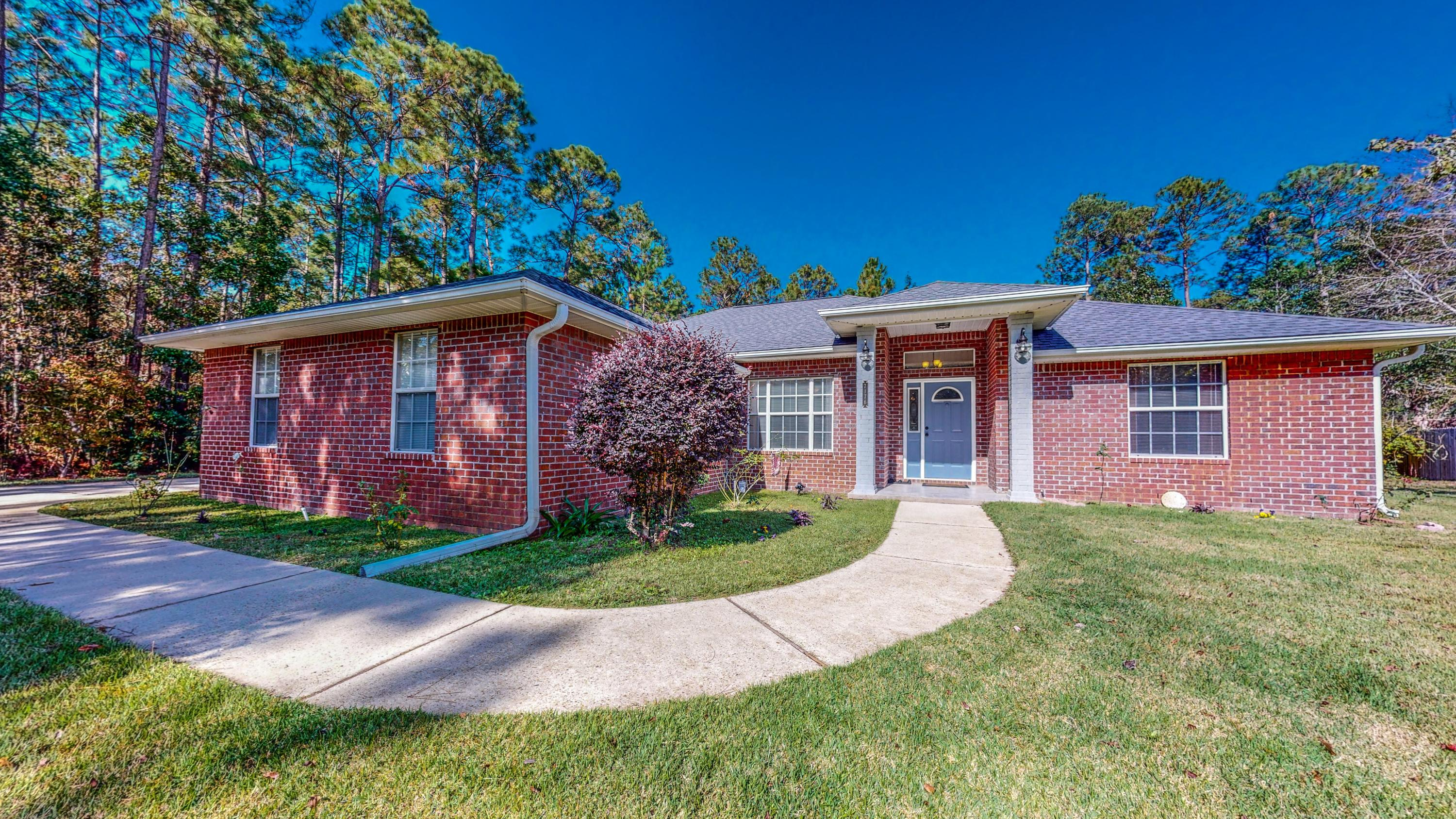 Photo of home for sale at 7176 Freedom, Navarre FL