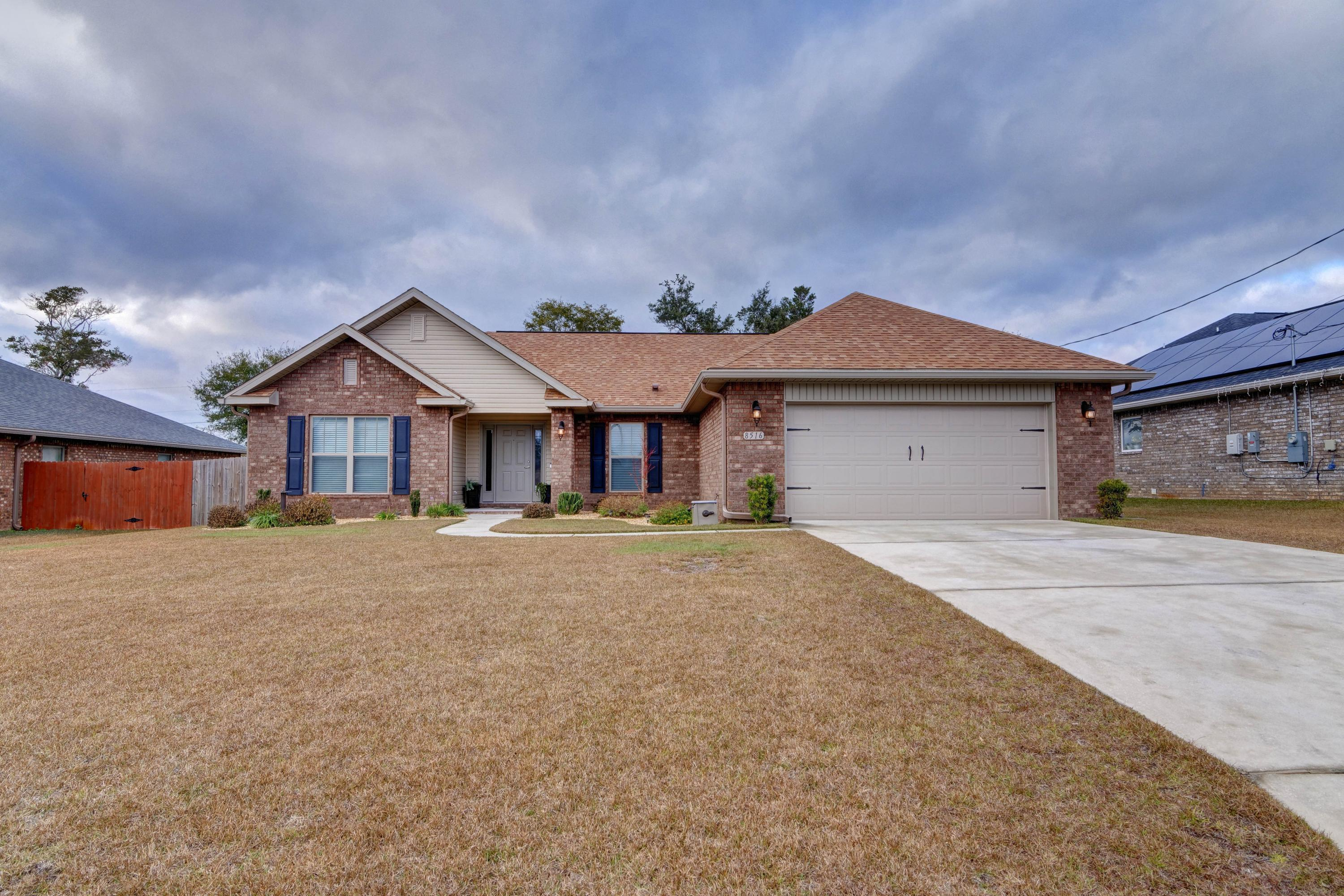 Photo of home for sale at 8516 Holley Hills, Navarre FL