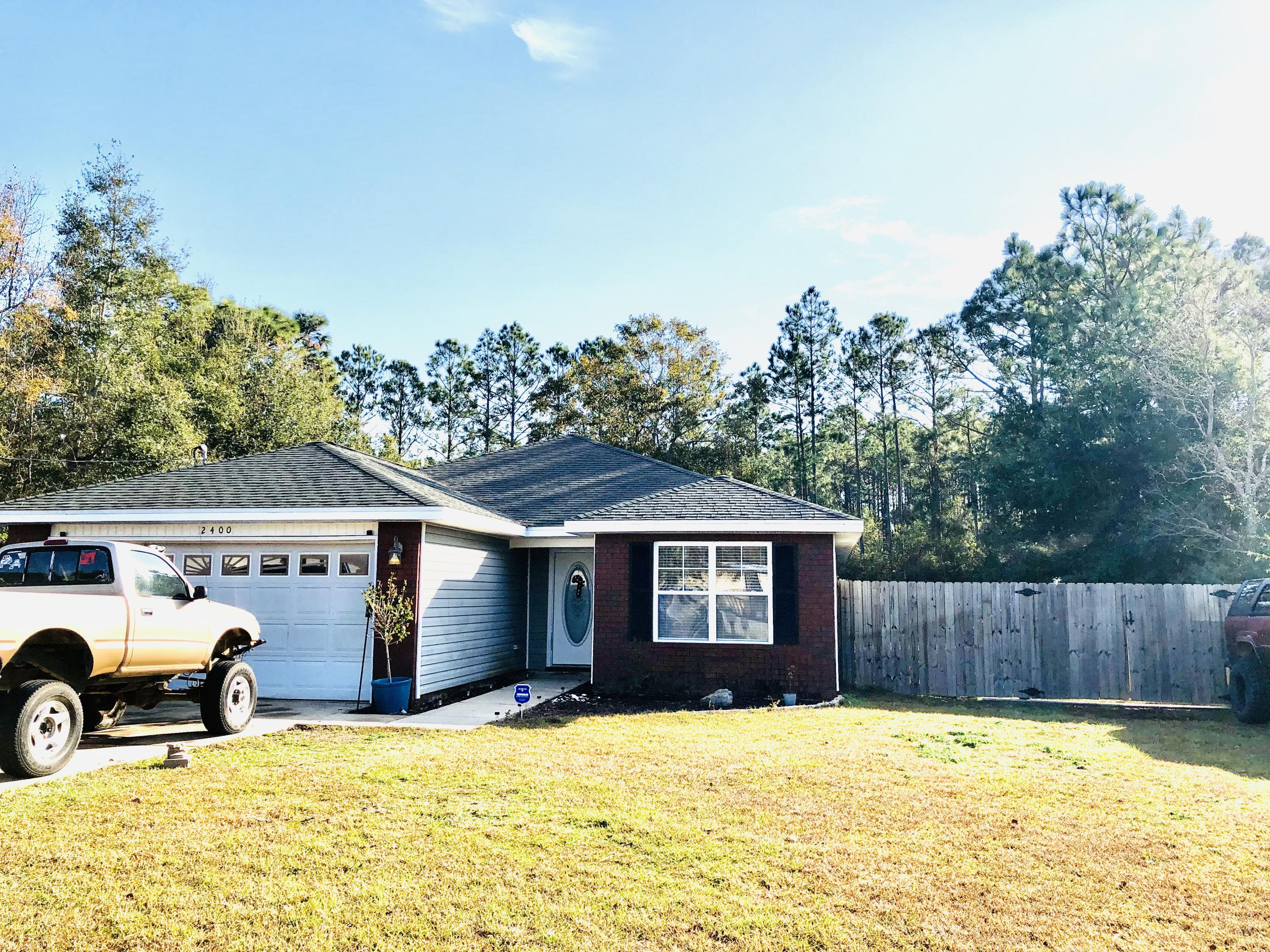 Photo of home for sale at 2400 Frontera, Navarre FL