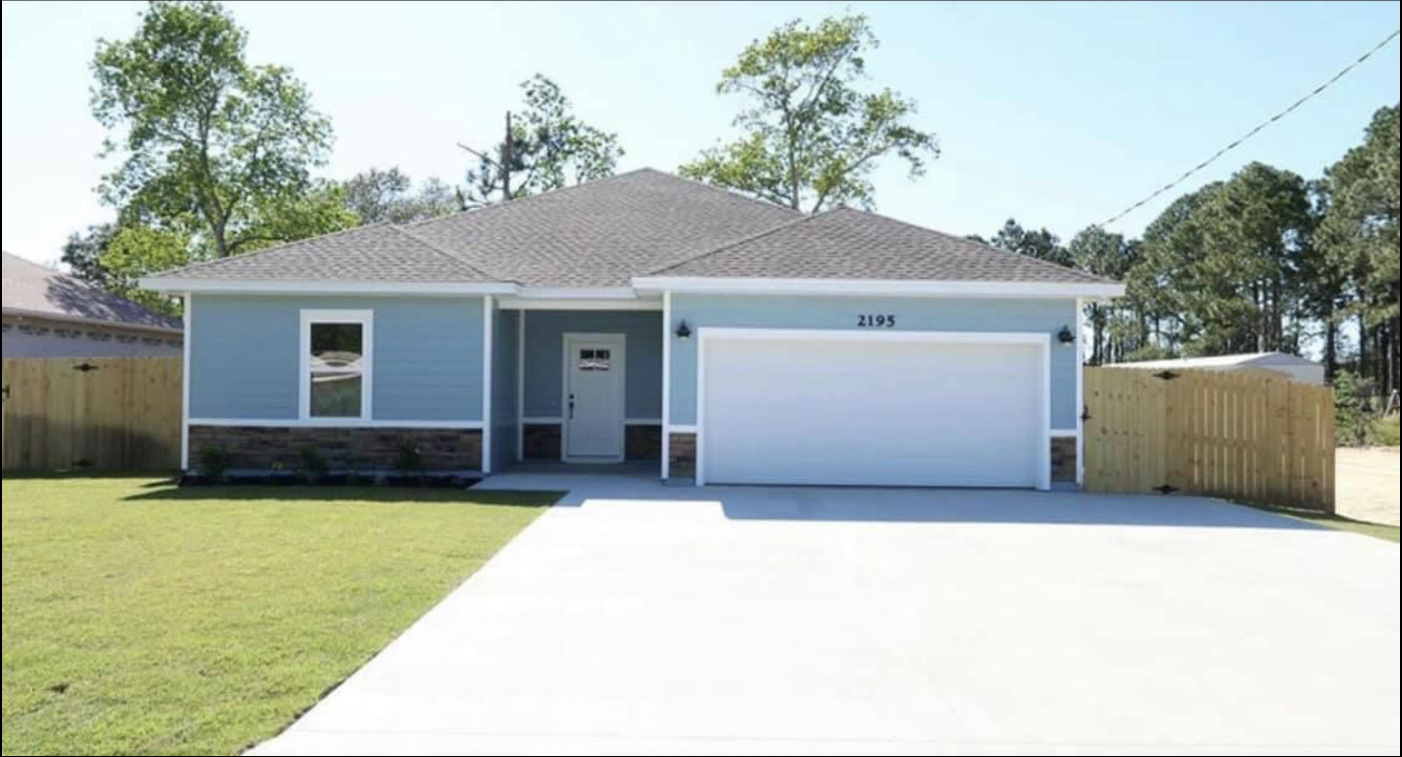 Photo of home for sale at 2195 Wind Trace, Navarre FL