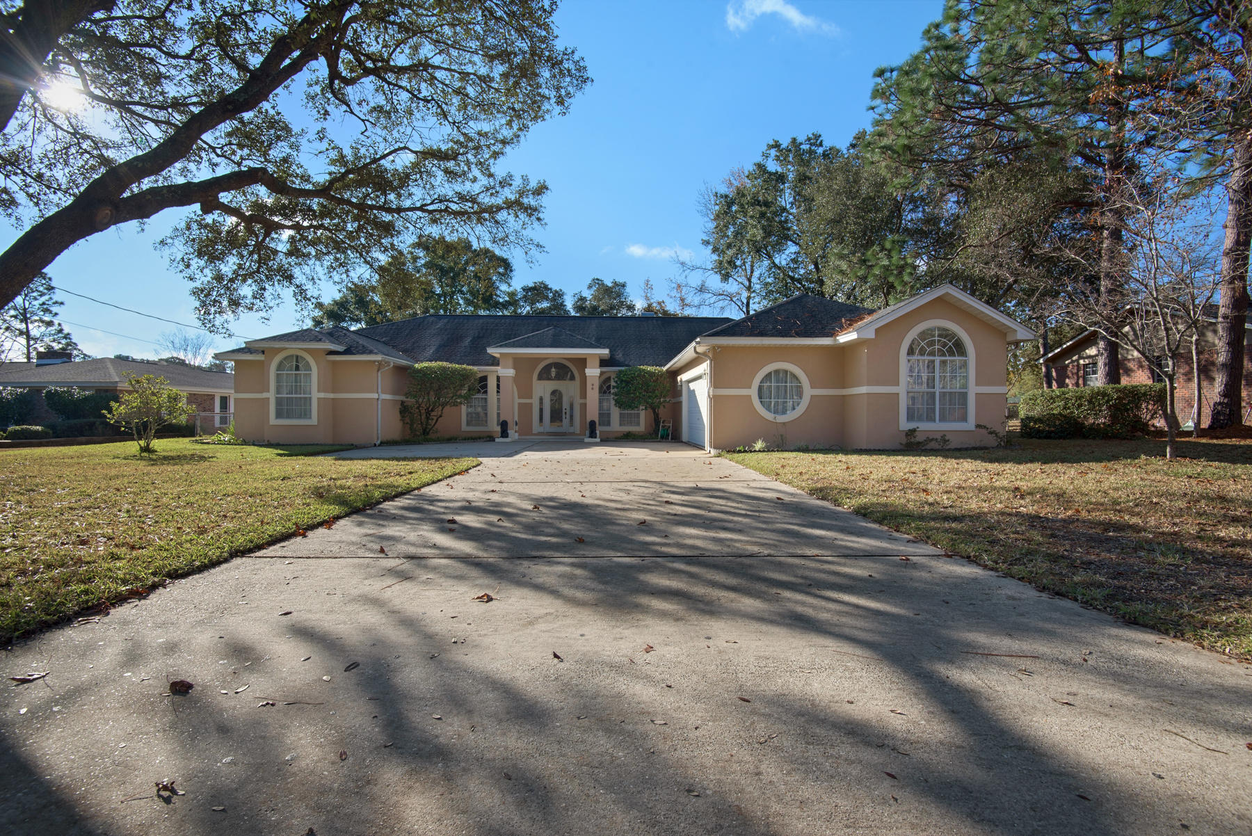 Photo of home for sale at 96 Country Club, Shalimar FL