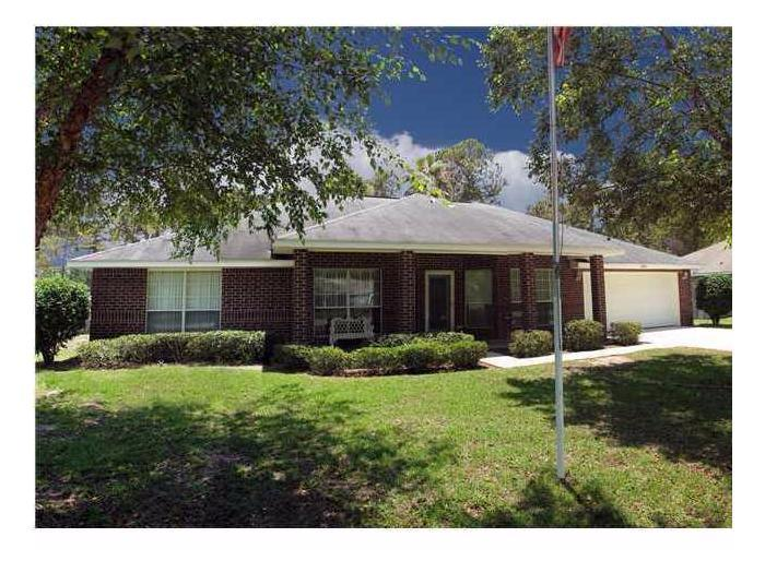 Photo of home for sale at 7527 Loop St, Navarre FL