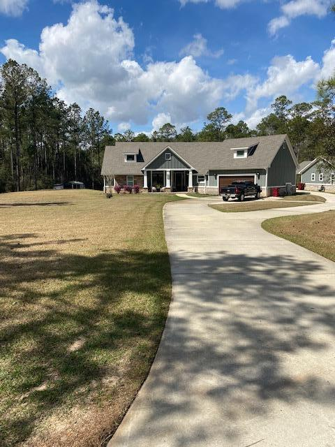 Photo of home for sale at 6895 Oser, Milton FL