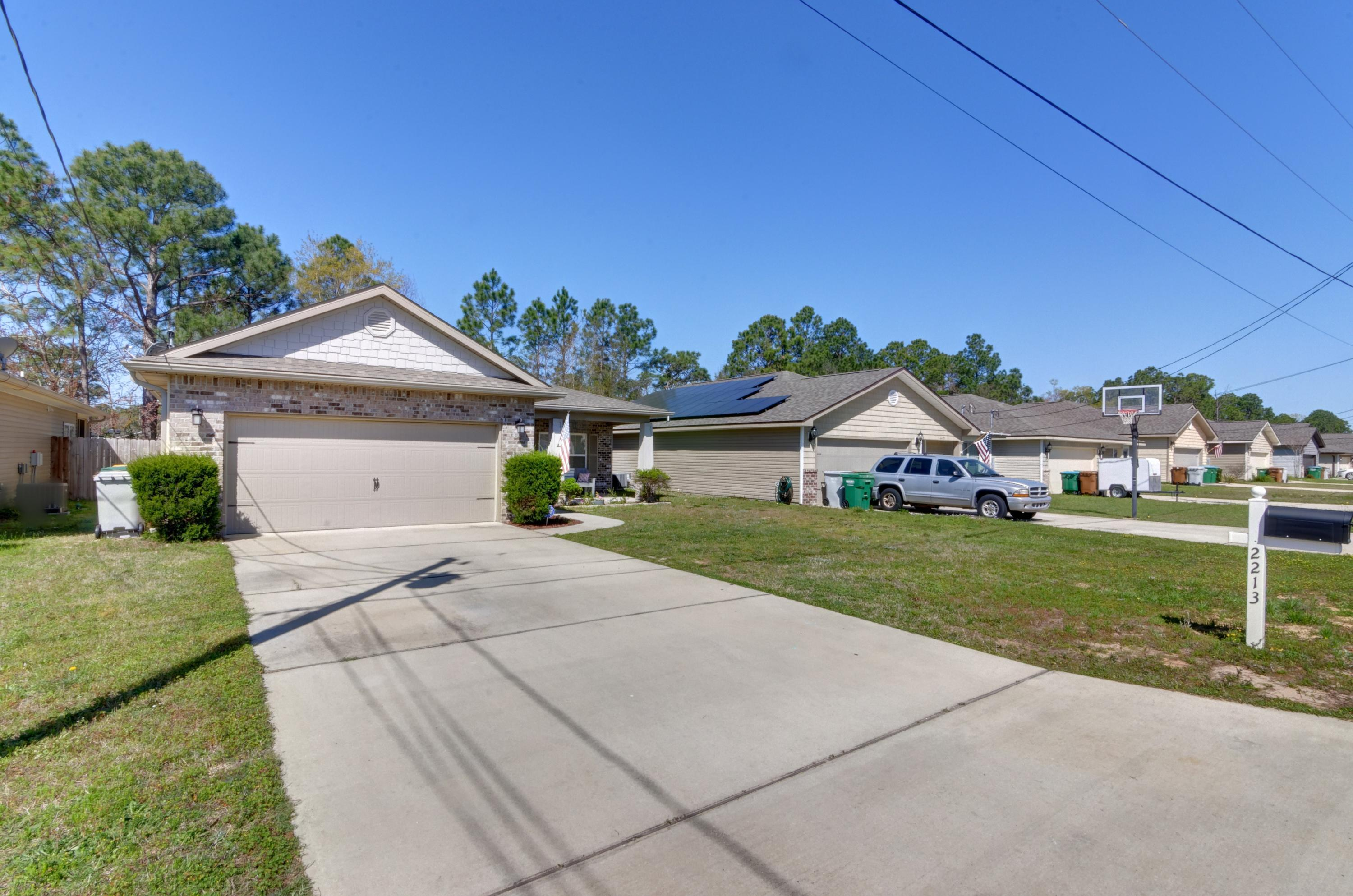 Photo of home for sale at 2213 Tom, Navarre FL