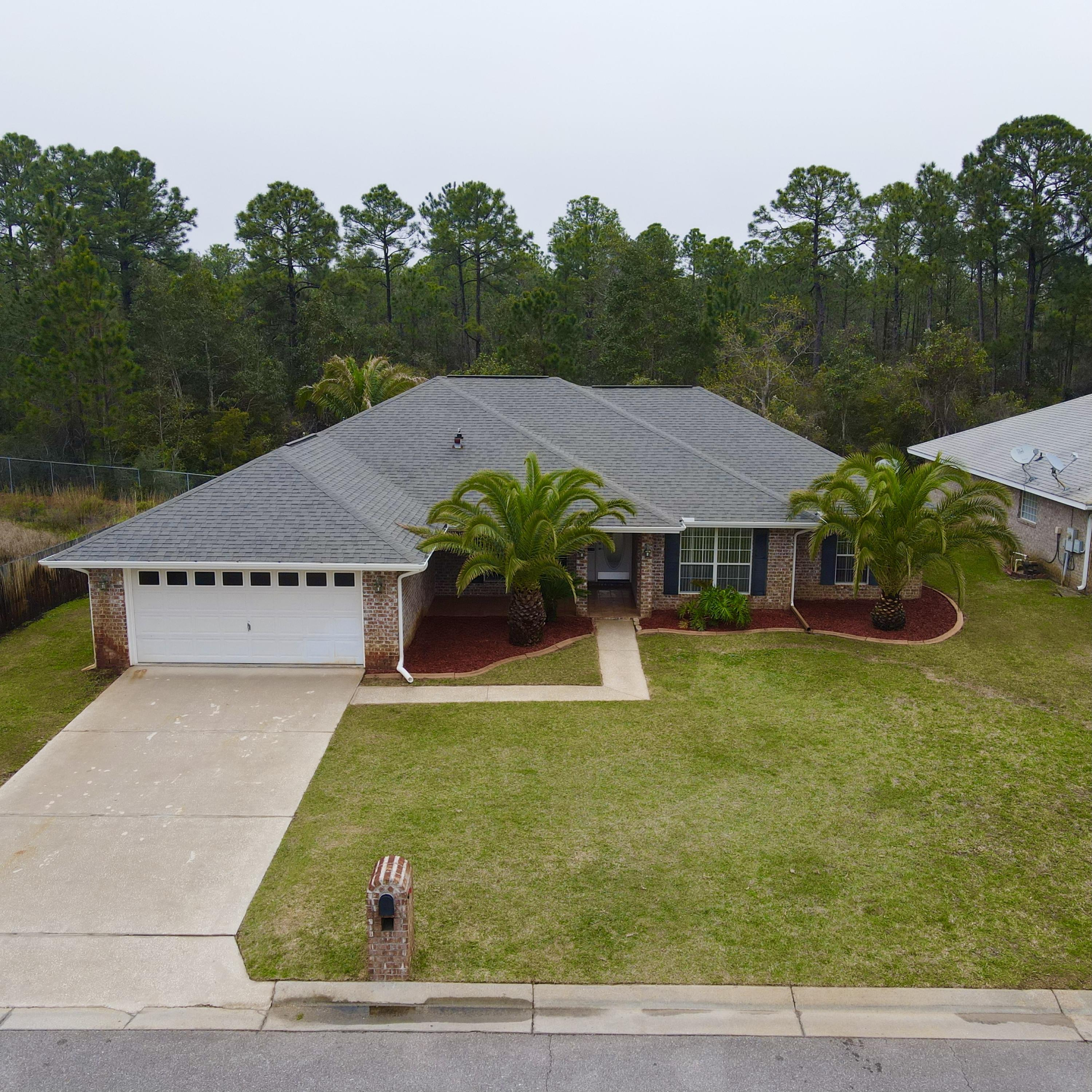 Photo of home for sale at 9708 Parker Lake, Navarre FL