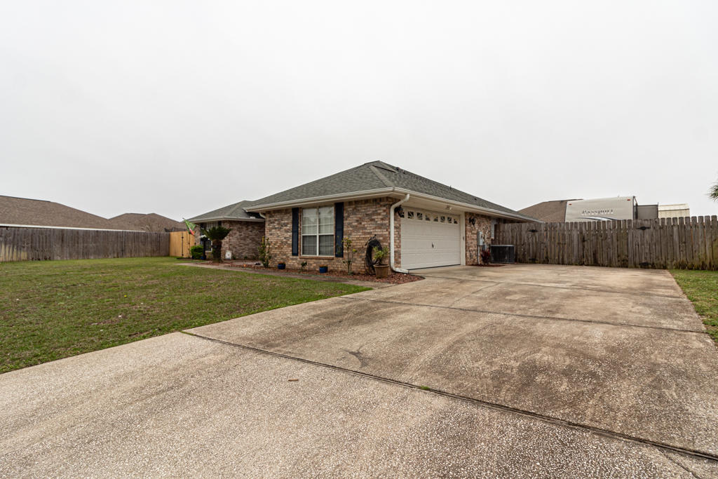 Photo of home for sale at 9771 Parker Lake, Navarre FL