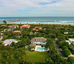 Unique North End opportunity! Over sized property within steps of the best beach on the Island. Exceptional Caribbean style home boasts an abundance of privacy as the adjacent vacant lot is included totaling over 29,000+/- sq. ft. of pristine property. A flawless design includes 4 bedrooms/6.1 baths, bonus room and exceptional outdoor areas. The specific attention to detail includes Leeds custom cabinetry throughout, hardwood and marble flooring, Lutron lighting, whole house audio system, elevator, wood paneled library, temperature controlled wine room, impact windows and doors and much more. Custom Built in 2010, the home has a total of over 7,500 +/- sq.ft. with room to expand.