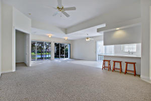 Fantastic rarely available Extended Oakmont Model in the gated community of Riverwalk in West Palm Beach. This home features 3 bedrooms, 2 baths and large front office/den just off the kitchen. Volume ceilings and open spaces make this a wonderful place to call home. Top it all of with a spacious two car garage, screen in patio with Hot Tub and lovely water views. The community amenities include several pools, tennis courts, restaurant, Town Center, and miles of walking trails over several lakes and bridges. A truly wonderful place to call home.