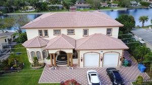 Casa Unifamiliar por un Venta en 7831 Pine Tree Lane Lake Clarke Shores, Florida 33406 Estados Unidos