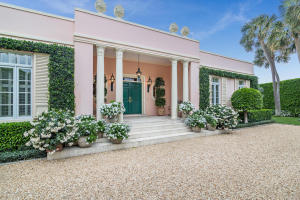 This stunning, classically designed Palm Beach Regency was designed by AmesBennett and built in 1970. The formal gardens that surround the property weredesigned by world renowned landscape architect, Mario Nievera. The houseis situated on a double lot, 27,300 sq. ft. and boasts over 5,300 sq. ft. of living space including a beautiful outdoor loggia that is ideal for entertaining. The home boasts 3 bedrooms, 3 baths and two half baths with a lovely pool, separate staffaccommodations, a full house generator, and 2-car garage.