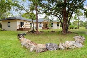 Casa para uma família para Locação às 4935 Lame Panther Lane 4935 Lame Panther Lane Loxahatchee, Florida 33470 Estados Unidos